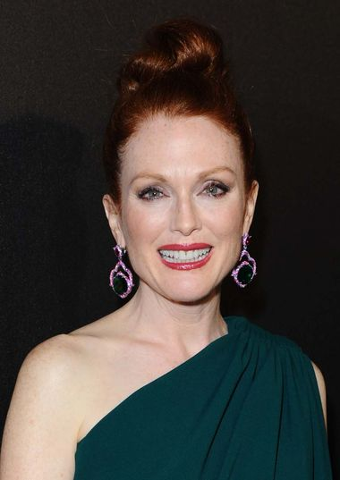Julianne Moore attended the Hunger Games party wearing a pair of earrings from Chopard's 2014 Red Carpet collection - the first time these colourful jewels, set with 44ct emeralds surrounded by pink sapphires and rubies, made a red carpet appearance.