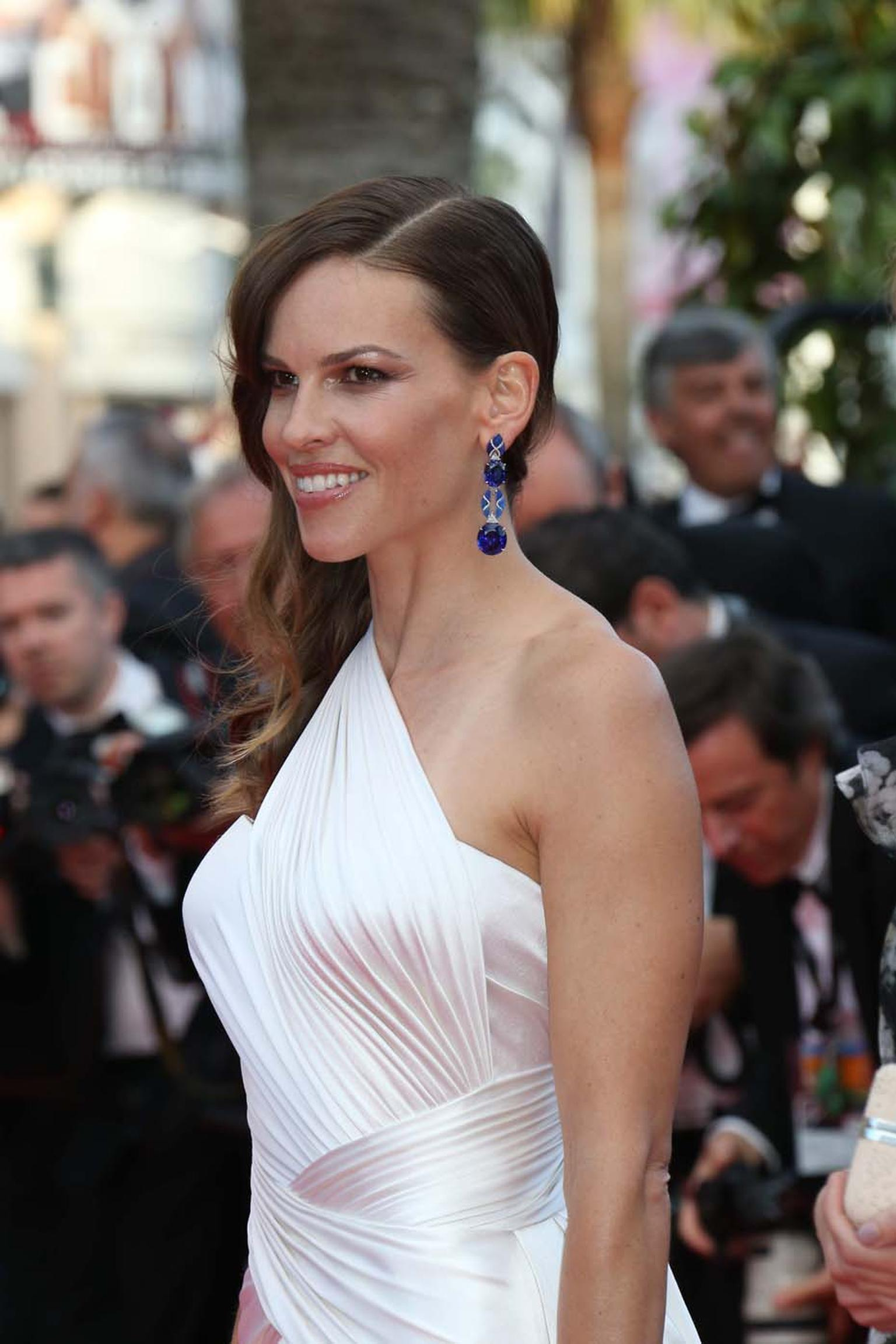 Actress Hilary Swank wore Chopard on the Cannes red carpet including earrings in white gold set with tanzanites (102cts), opals (8cts) and diamonds.
