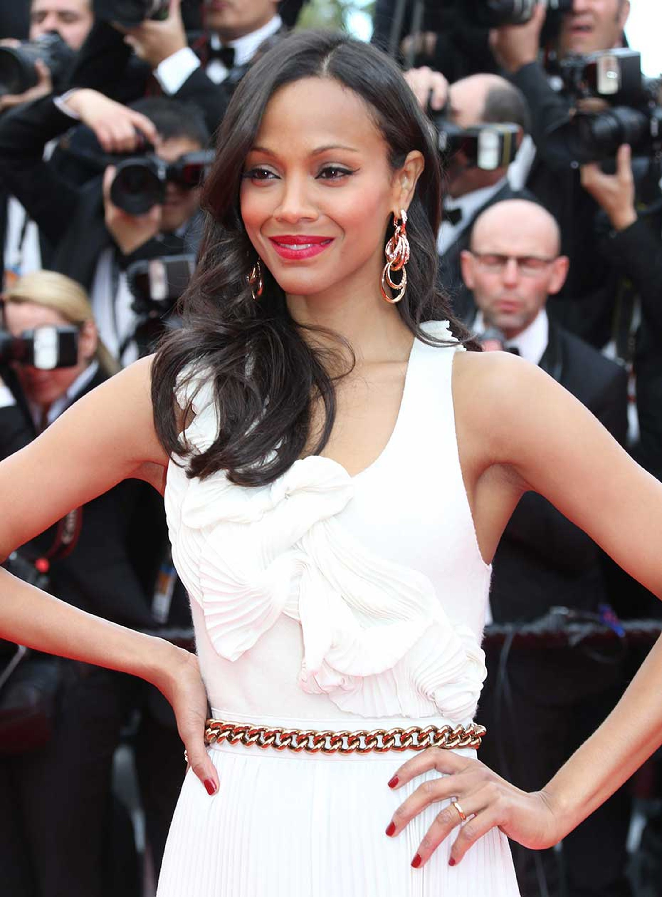 Zoe Saldana paired her pretty Victoria Beckham dress with Catene earrings and an Onde ring, both in rose gold and diamonds, by De GRISOGONO