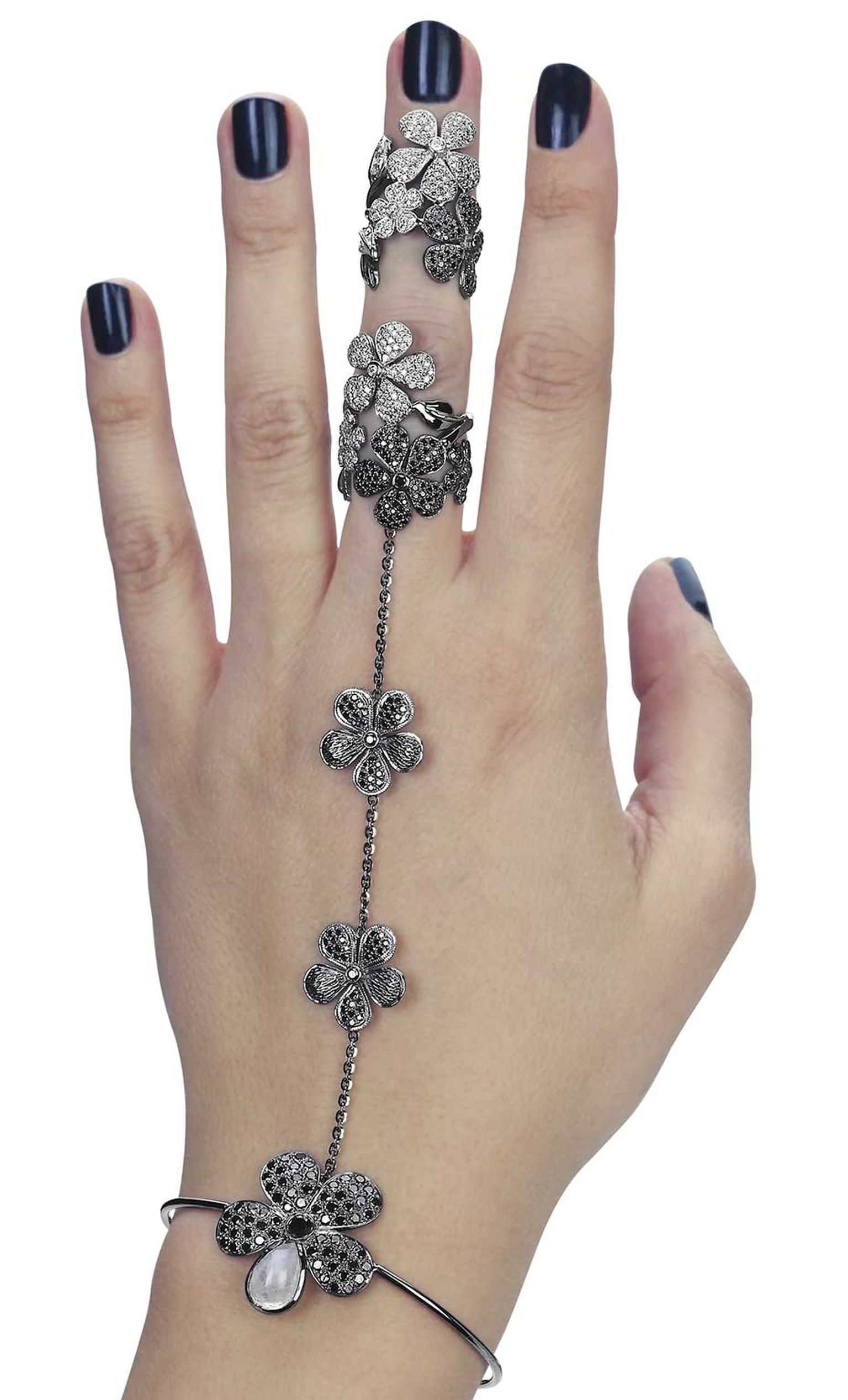 Colette's flower hand jewel wraps around the wrist and middle finger in a fashionable mix of black and white diamonds. See it at the Couture Show Las Vegas