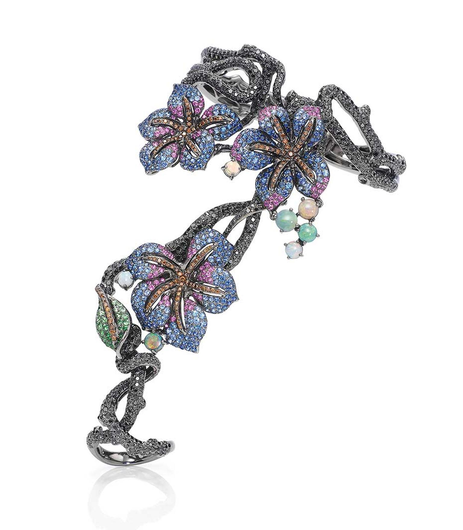 See Wendy Yue's Midnight Flora hand bracelet with black diamonds, opals, tsavorites, blue sapphires and pink sapphires in black gold at the Couture Show Las Vegas