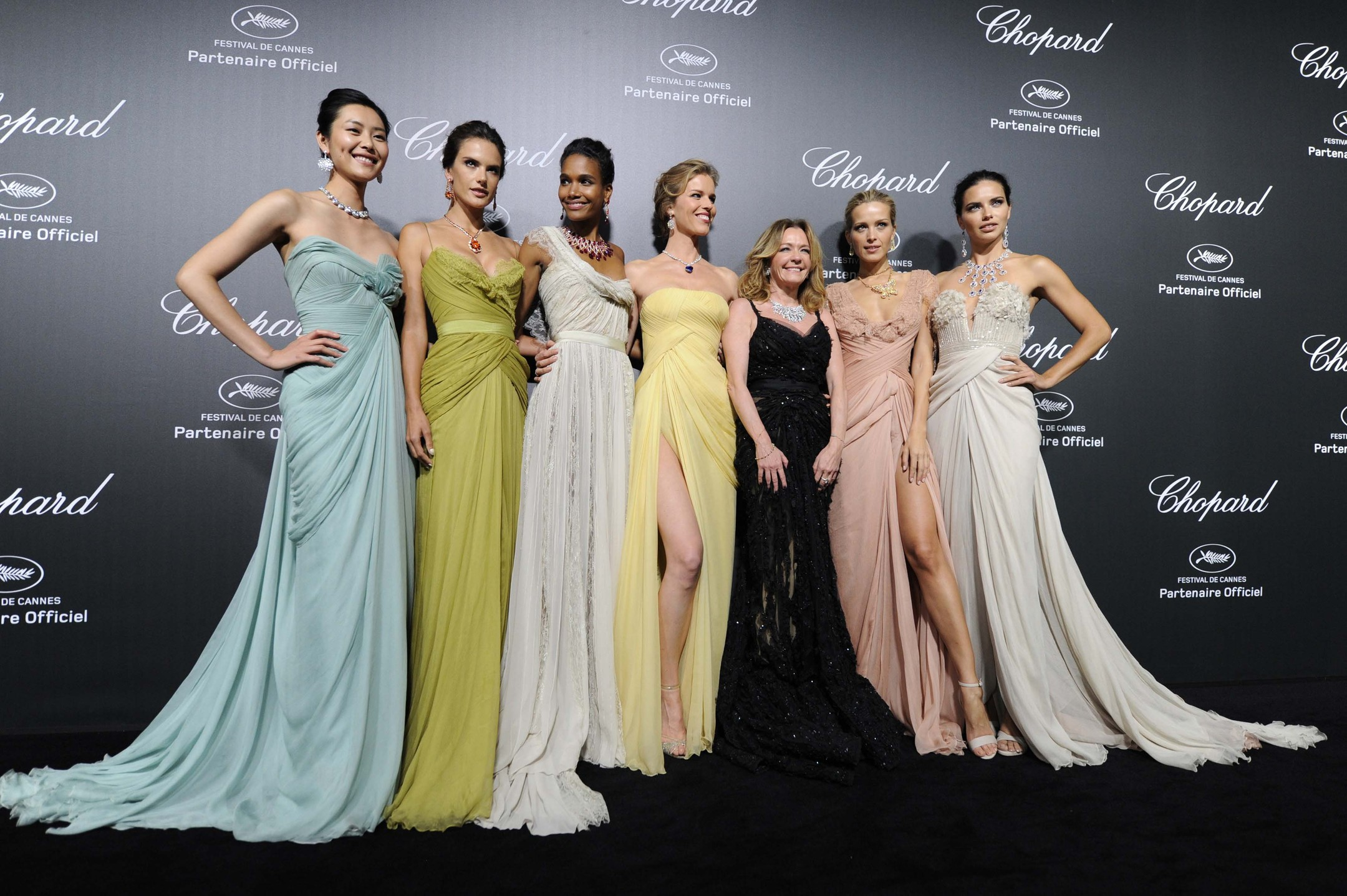 Supermodels Liu Wen, Alessandra Ambrosio, Arlenis Sosa, Eva Herzigova, Petra Nemcova and Adriana Lima lined up either side of Caroline Scheufele, co president of Chopard - dressed in black - at the Swiss jeweller's exclusive Backstage party wearing Elie S