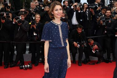 Film director and fashion queen Sofia Coppola looked effortlessly sophisticated in a vintage-style Michael Kors dress and single row of Chopard diamonds around her wrist