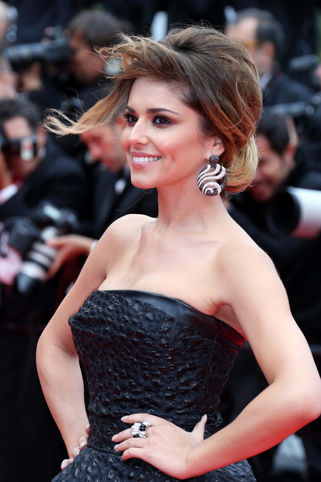 Cheryl Cole shows off a pair of monochrome de GRISOGONO earrings set with black and white diamonds and a diamond and a jet ring from the Gocce collection at the Cannes Film Festival 2014.