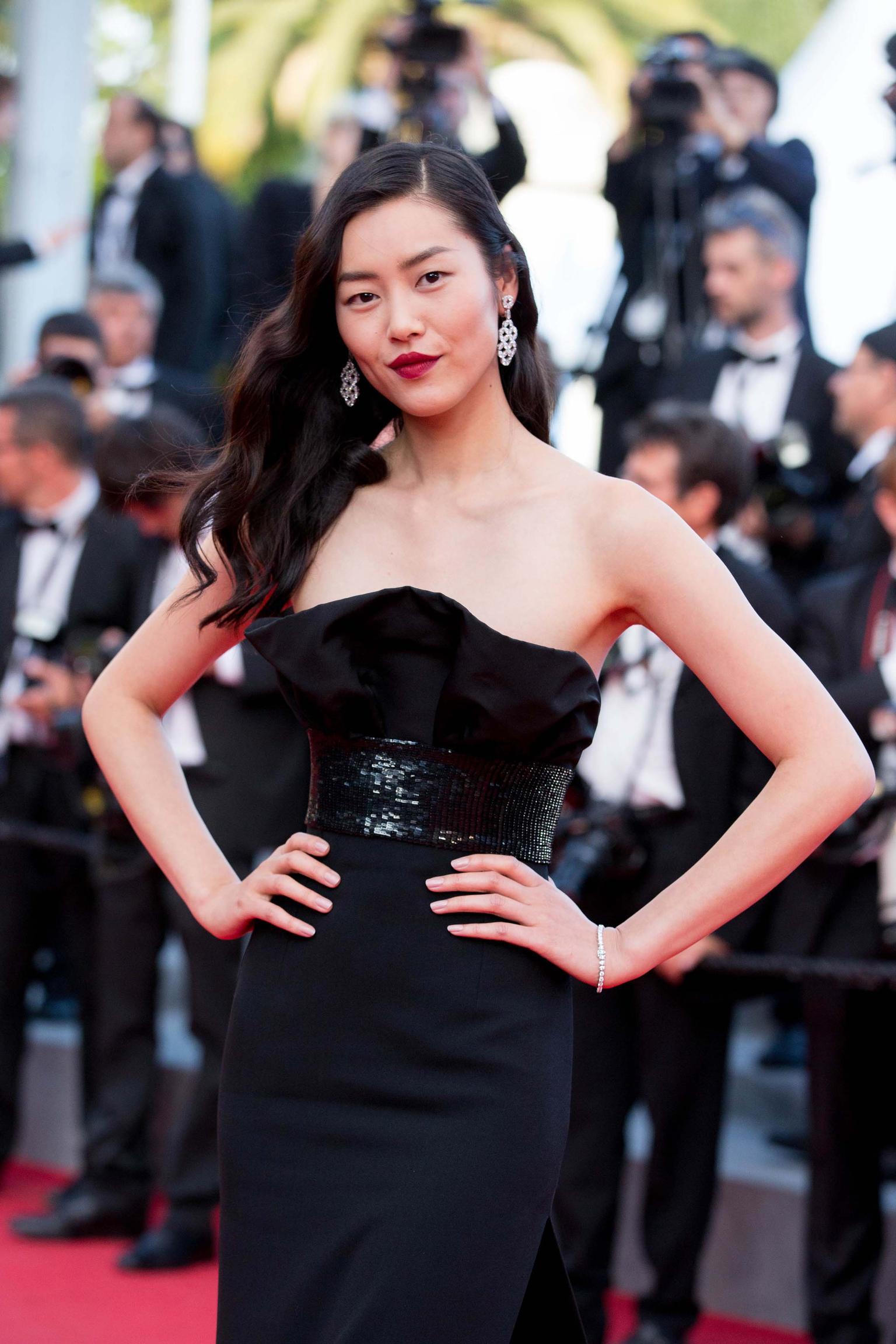 Model Liu Wen chose a pair of marquise-cut diamond drop earrings and a diamond line bracelet for the premiere of Two Days, One Night at the Cannes Film Festival