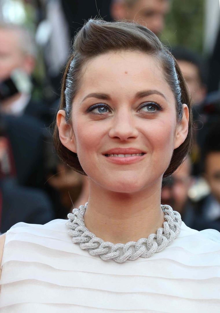 Marion Cotillard looked impossibly pretty in a pleated Dior dress teamed with Chopard jewellery at the Cannes Film Festival 2014.