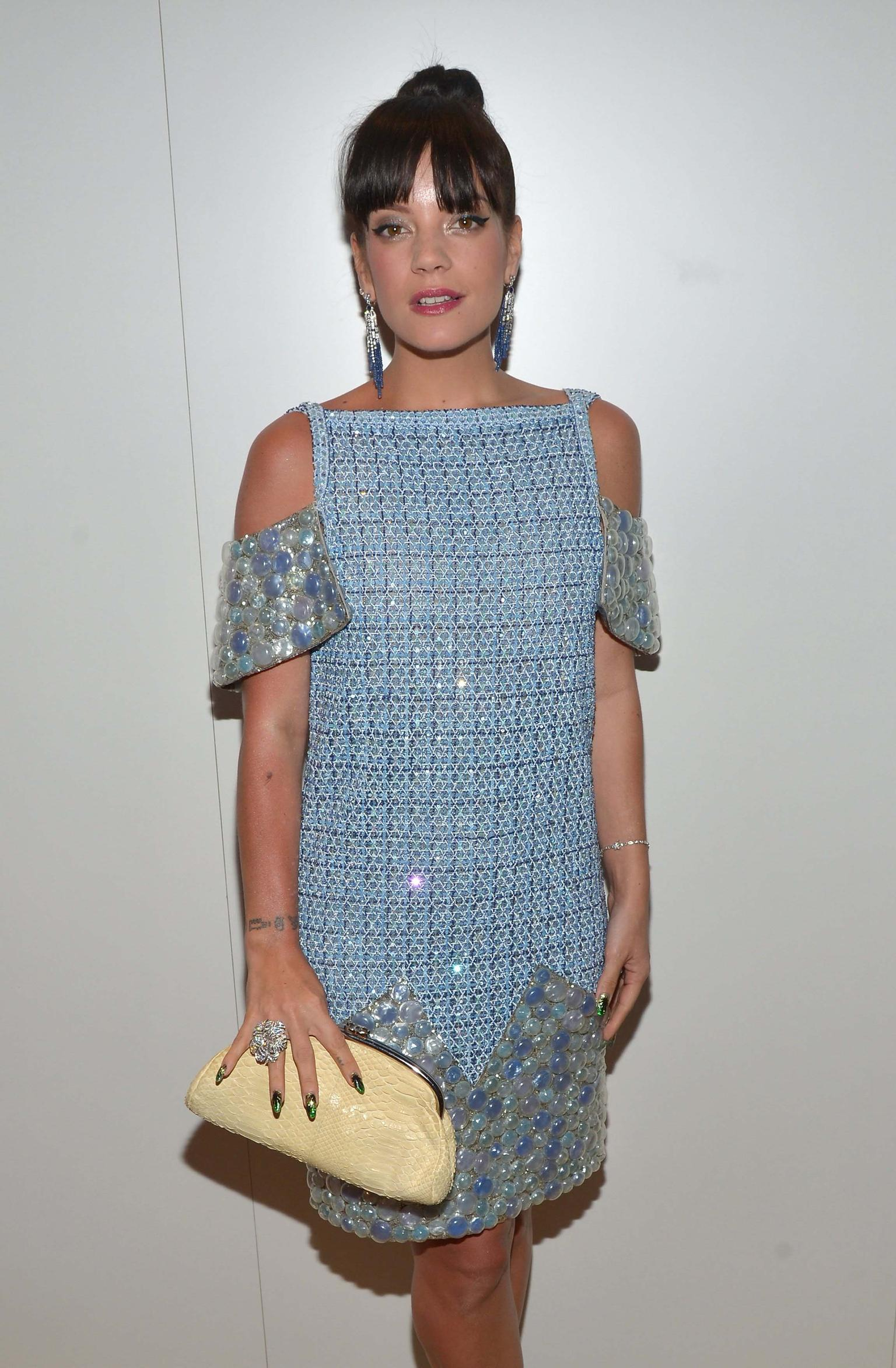 "Chanel hosted a dinner with Vanity Fair France at the exclusive Tetou restaurant on day seven of the Cannes Film Festival. Lily Allen accessorised her quirky Chanel ""bubble"" dress with sapphire drop earrings, a floral ring and a delicate bracelet, all by"