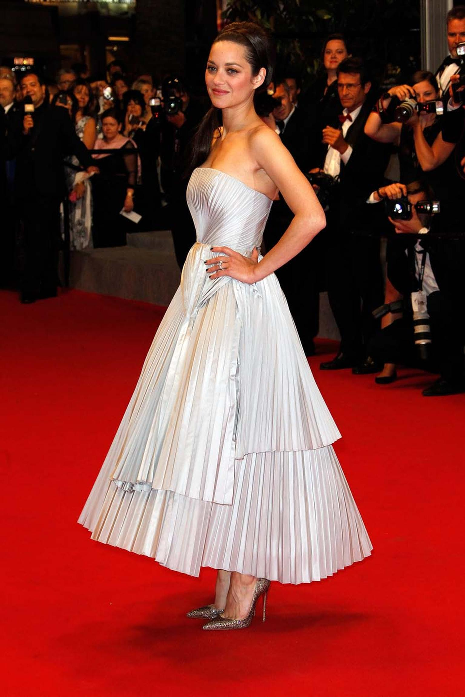 Marion Cotillard simply stuns on the Cannes Red Carpet in a Chopard diamond bracelet and earrings.