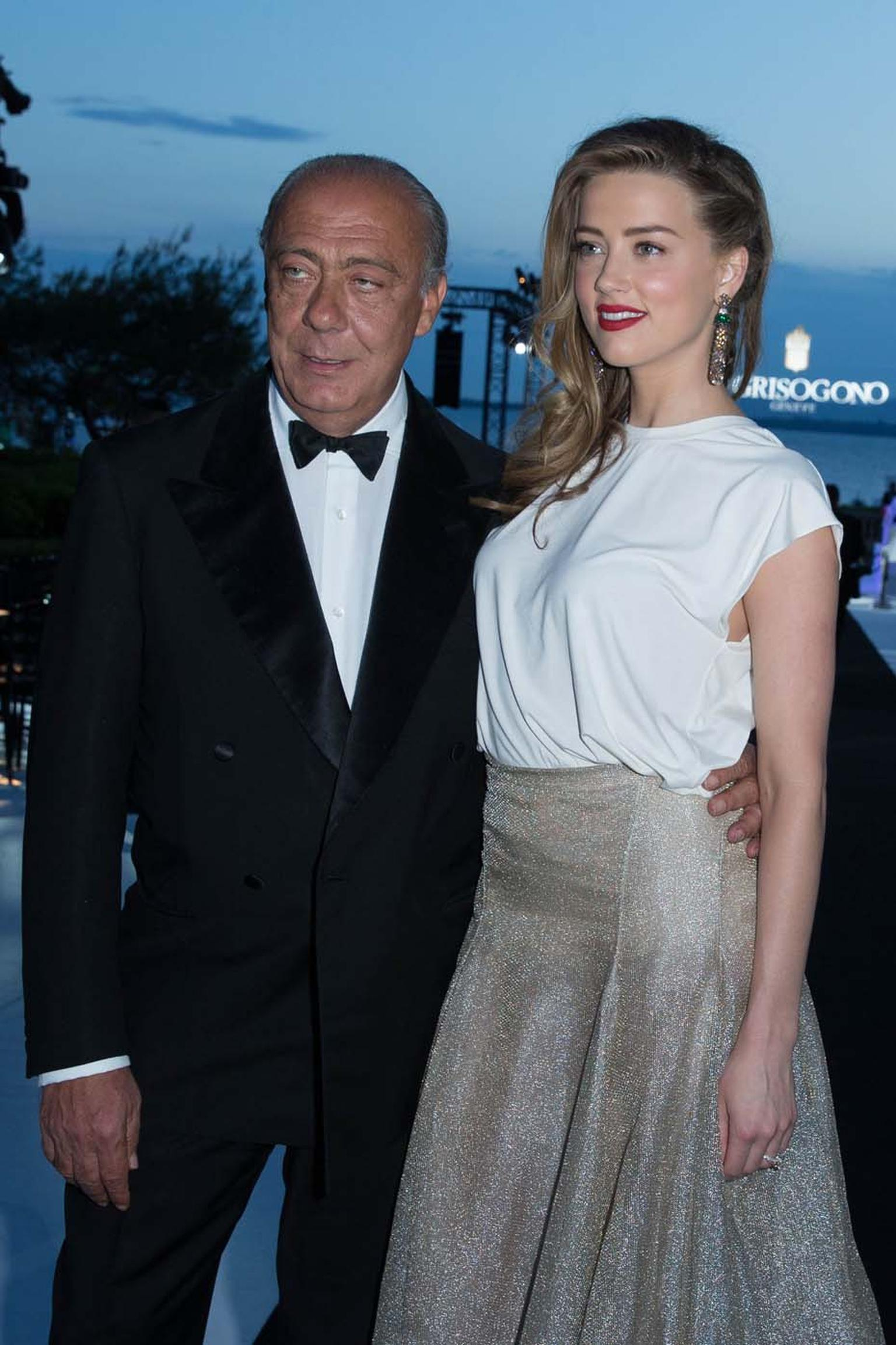 Amber Heard poses with de GRISIGONO founder Fawaz Gruosi during the Swiss jeweller's party at the Hôtel du Cap-Eden-Roc