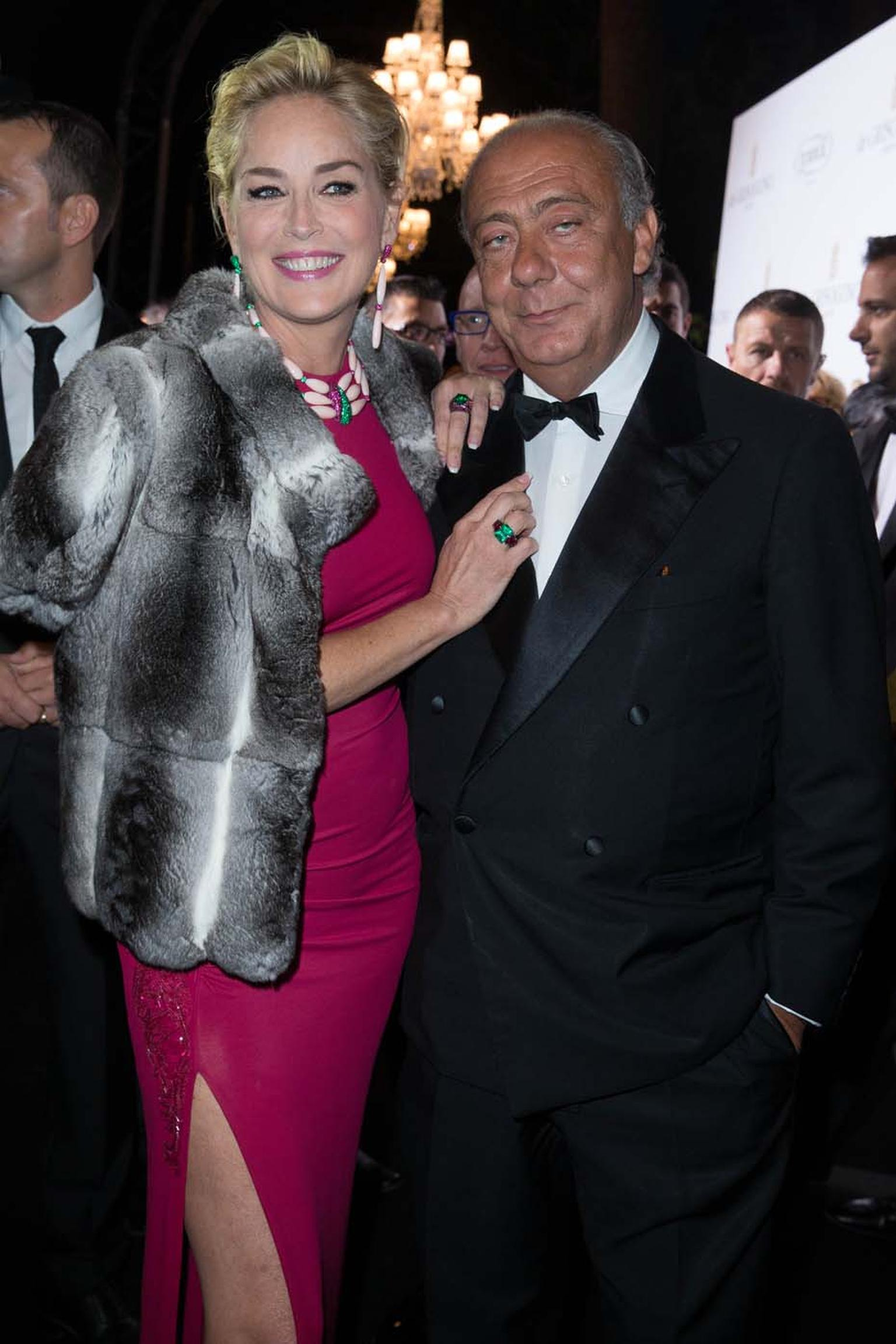 Posing with de GRISOGONO's founder Fawaz Gruosi, Sharon Stone shows off her evening's jewellery choices, which included a three-strand de GRISOGONO coral necklace and matching earrings