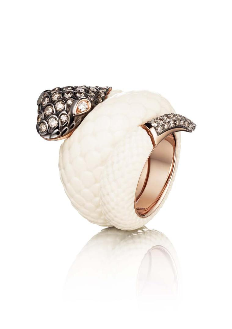 de GRISOGONO pink gold Serpent ring with mammoth tusk for the body and white and brown diamonds for the head and tail as worn by Cara Delevigne.