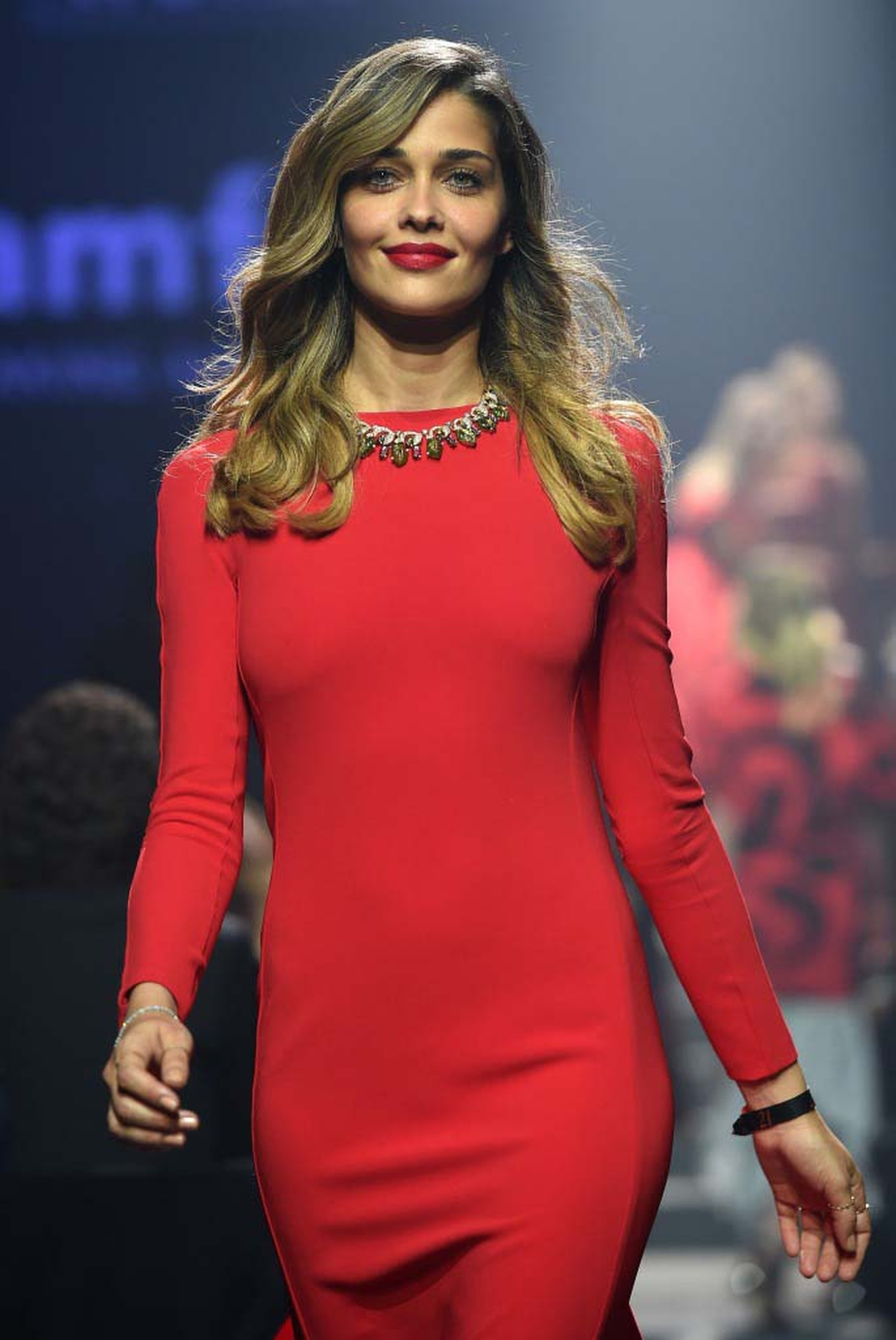 Lady in red Irina Shyak, wearing a one-of-a-kind Bulgari necklace, sauntered down the catwalk during the 2014 amfAR Charity Gala