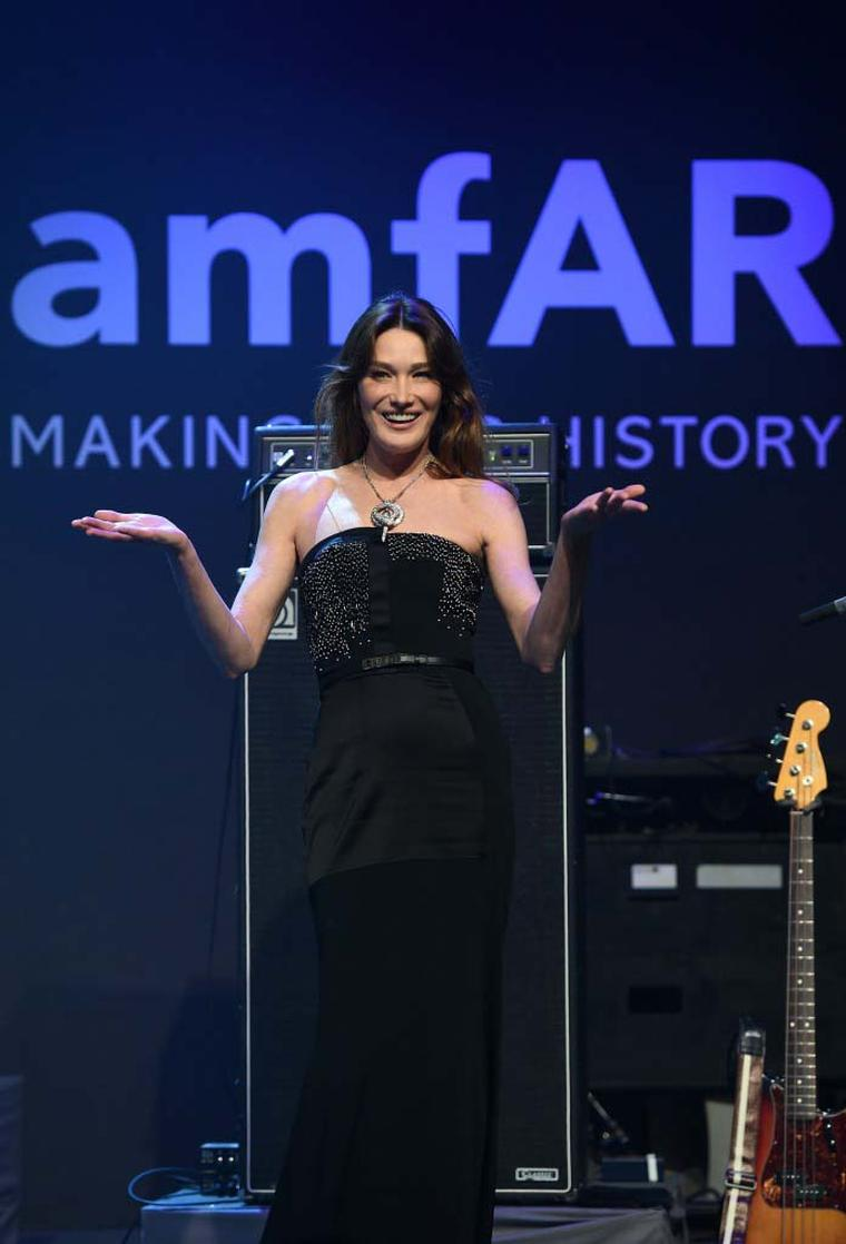 Bulgari ambassador and former first lady of France Carla Bruni-Sarkozy introduces the Bulgari Serpenti necklace that was auctioned for $546,000 during the amfAR Charity Gala in Cannes