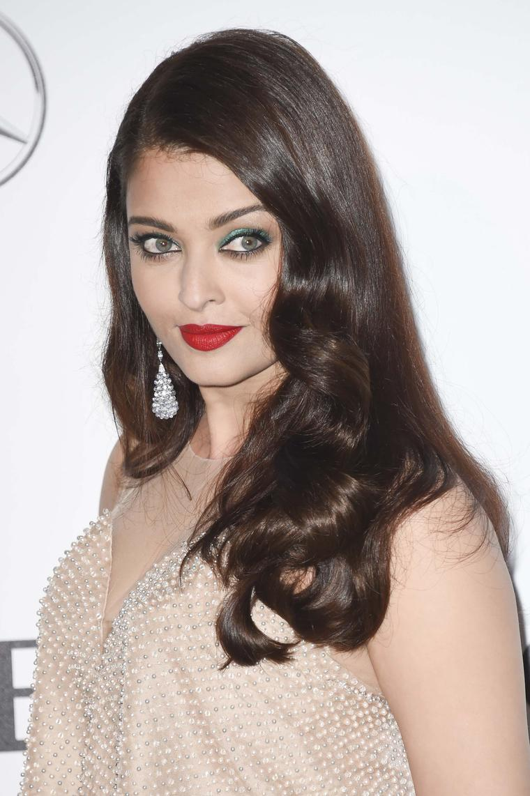 Actress Aishwarya Rai wore a pair of briolette cut pastel sapphires drop earrings from Chopard's Copacabana Collection that mirrored the beads on her nude-coloured gown