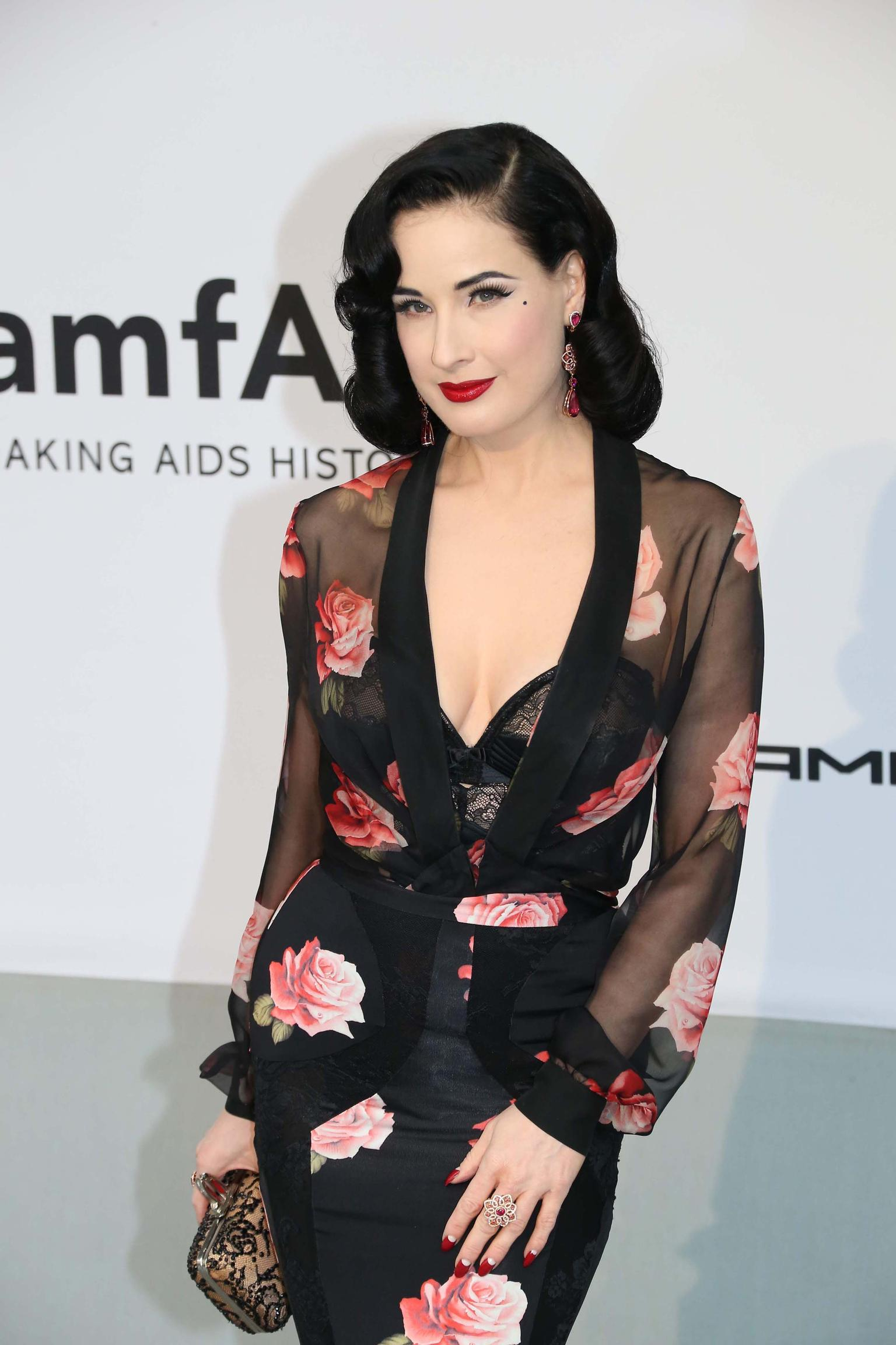 Dita Von Teese wore a pair of tourmaline and diamond earrings and a 5ct floral ruby ring, both by Chopard, to the amfAR Charity Gala in Cannes