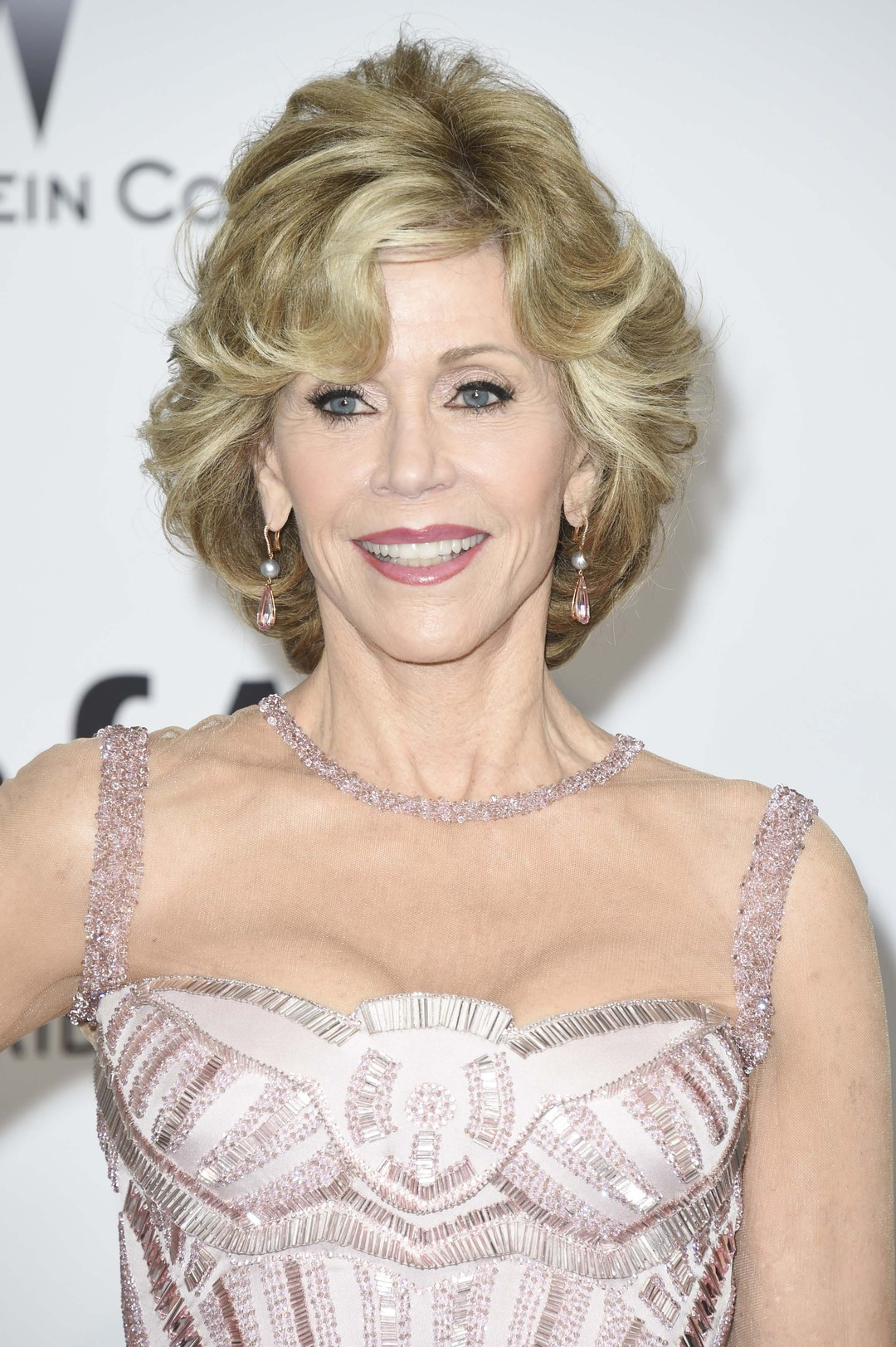 Actress Jane Fonda wore a pair of pear-shaped pink tourmaline and grey pearl drop earrings in rose gold