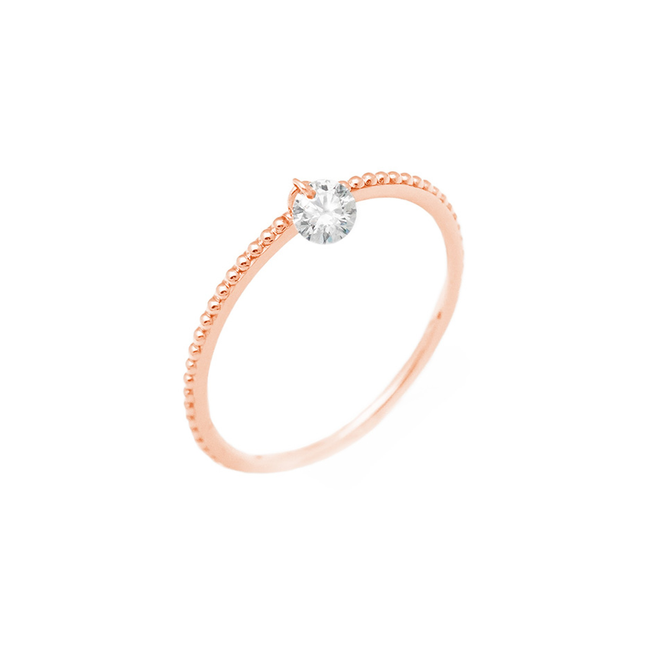 Raphaele Canot Set Free Diamonds collection pink gold ring with a pierced diamond suspended from the centre