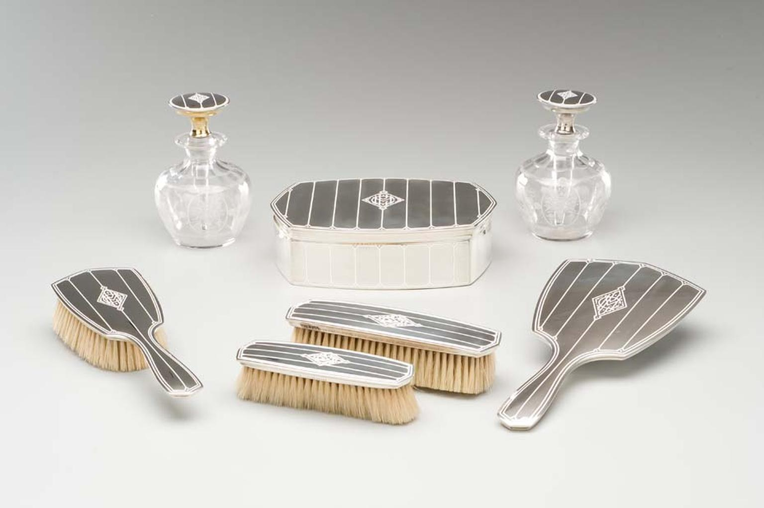 Cartier dressing table set with silver, enamel and glass circa 1915. Image: Courtesy Hillwood Estate, Museum and Gardens