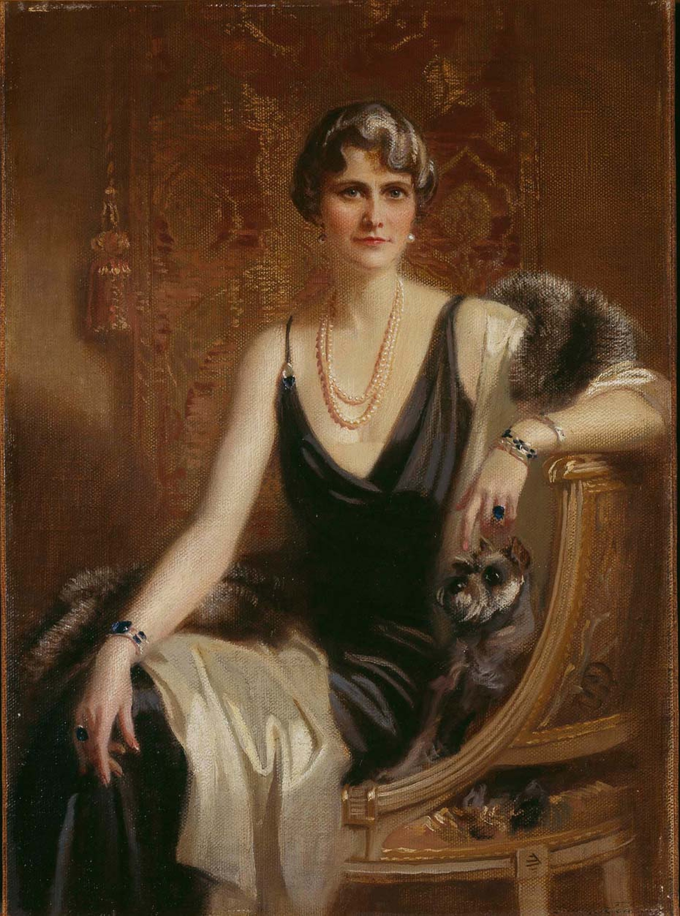 Portrait of Marjorie Merriweather Post wearing a Cartier diamond bracelet and sapphire bracelet. Image: Courtesy Hillwood Estate, Museum and Gardens