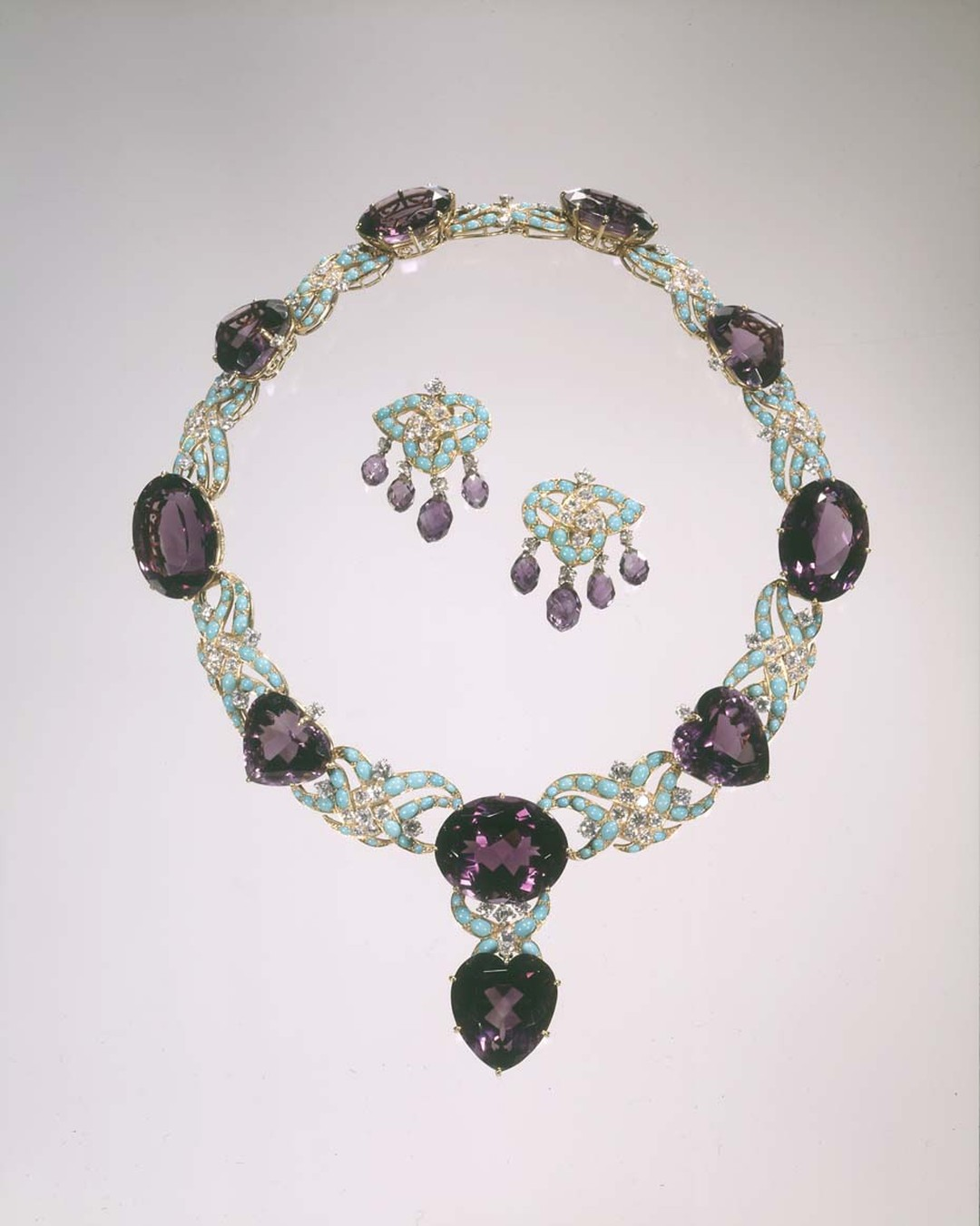 Cartier 1950-51 platinum and gold necklace and earrings with amethysts, turquoise and diamonds. Image: Courtesy Hillwood Estate, Museum and Gardens