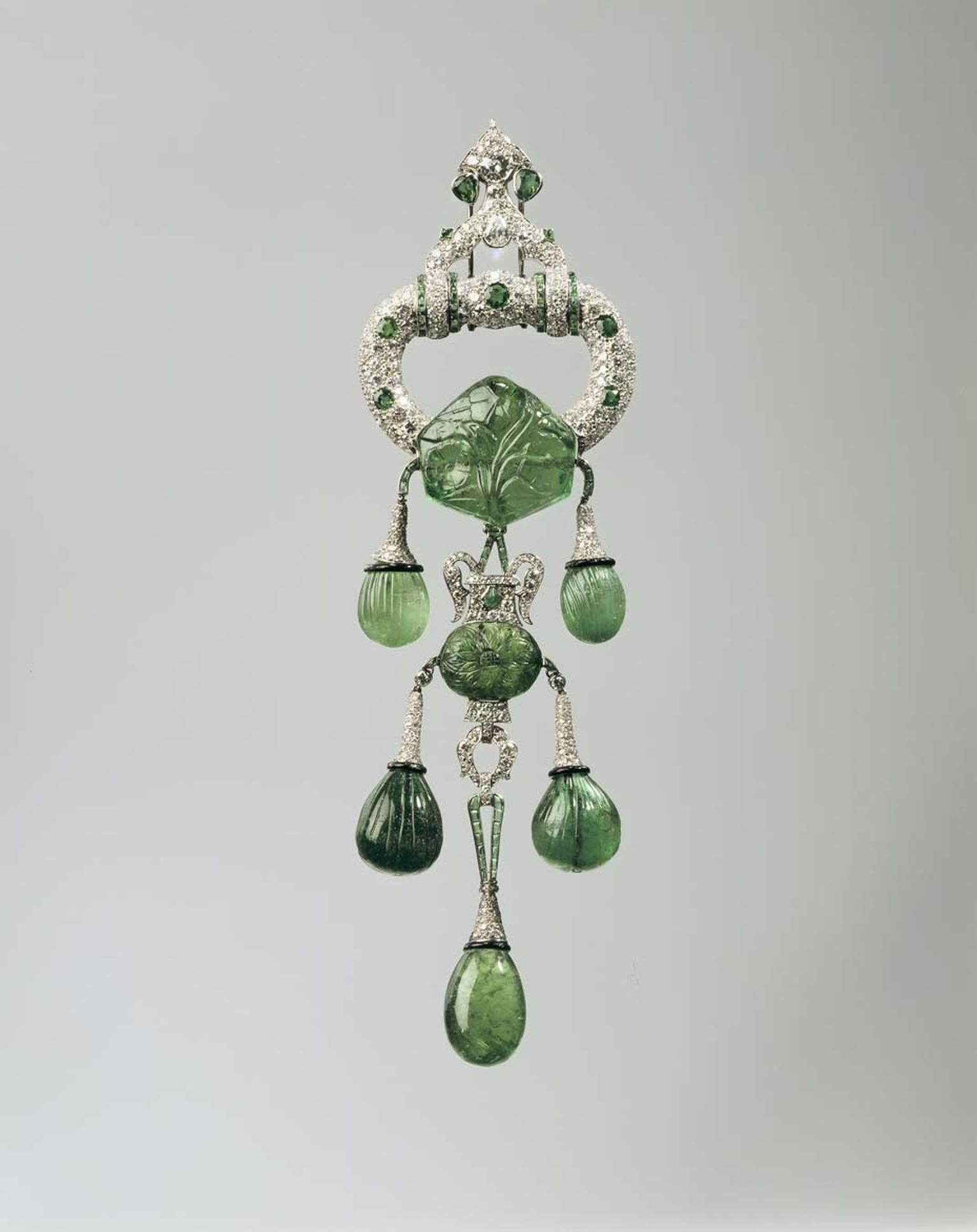 Cartier 1928 platinum pendant brooch with emeralds, diamonds and enamel. Image: Courtesy Hillwood Estate, Museum and Gardens.