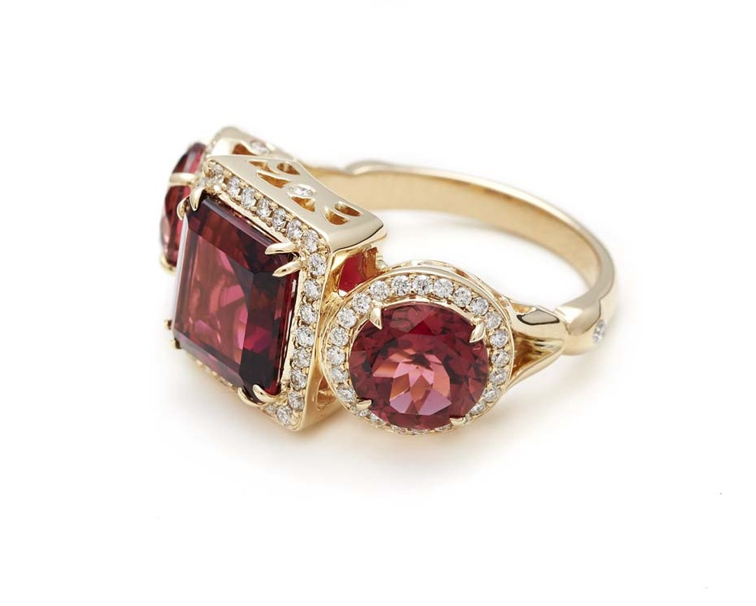 Anna Sheffield Astarte ring, set with two rose-cut pink tourmalines and a central princess-cut pink tourmaline in yellow gold