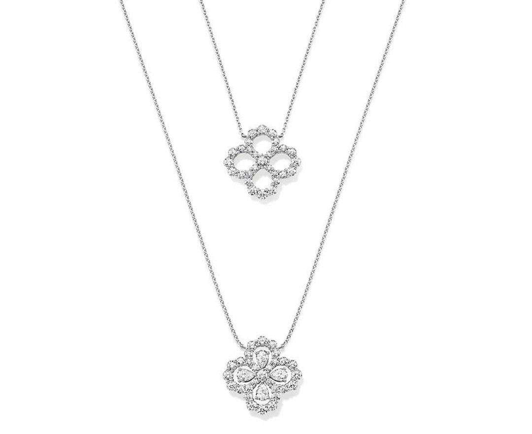 Harry Winston platinum Diamond Loop collection pendants in platinum with or without diamonds within the teardrop motif