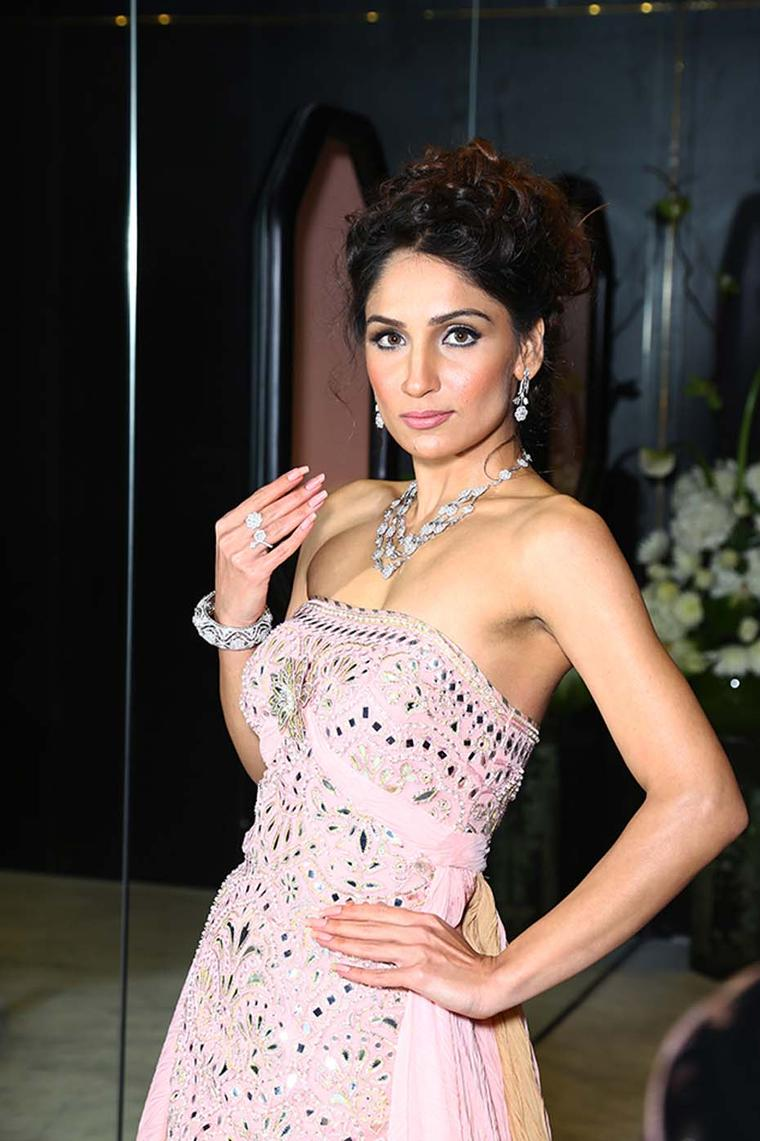 A model wearing Nirav Modi's Mughal Flower earrings, a three-row diamond necklace and a two-finger ring