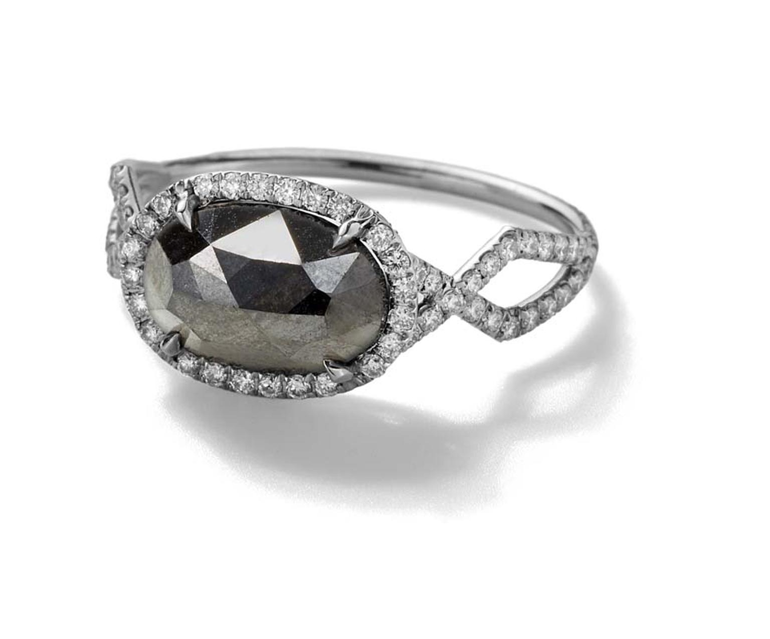 Monique Péan Mineraux engagement ring in recycled platinum, set with a black oval diamond and diamond pavé ($16,160)