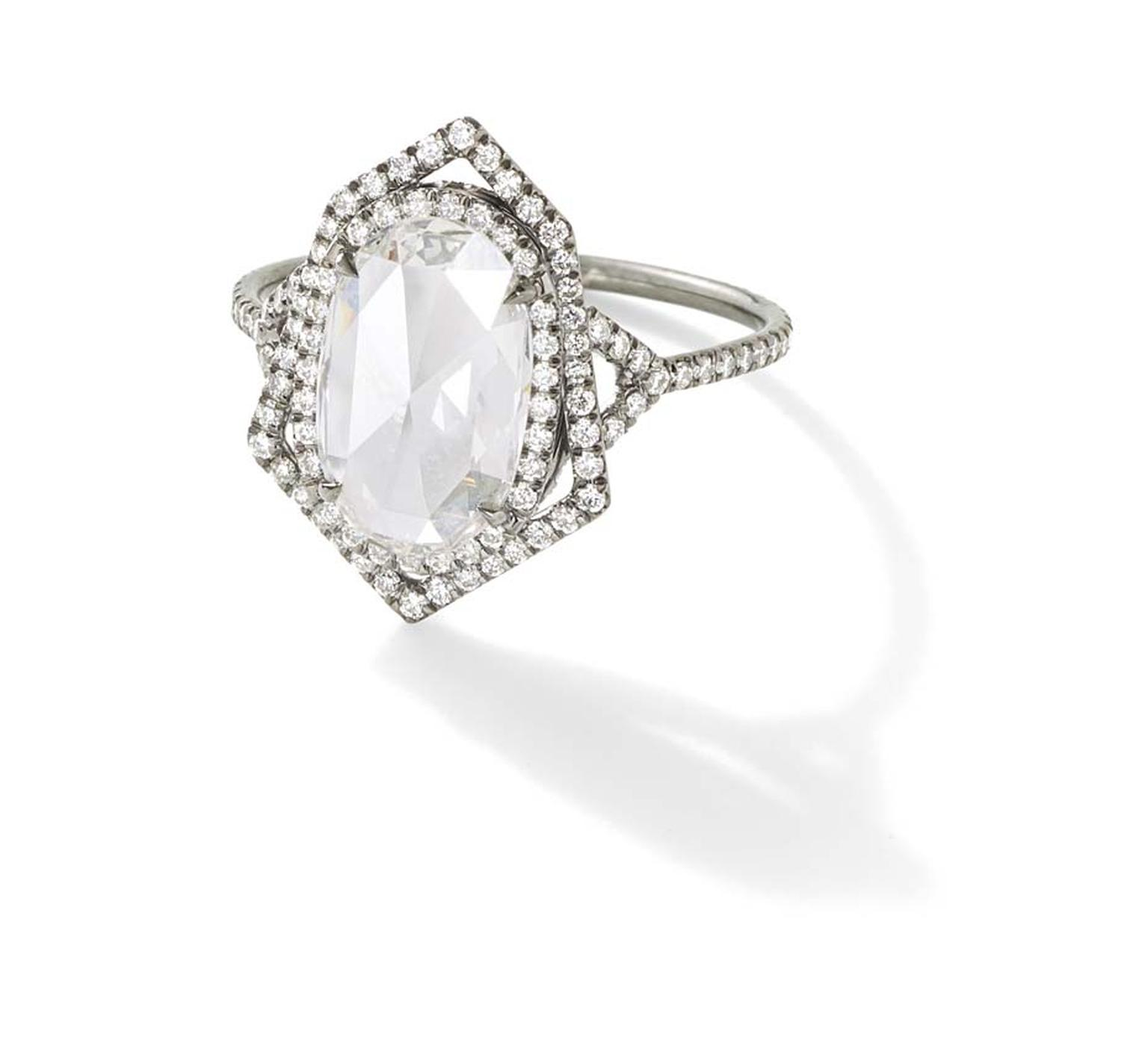 Monique Péan Mineraux engagement ring in recycled oxidised platinum, set with an antique white oval rose cut diamond and diamond pavé ($52,770)
