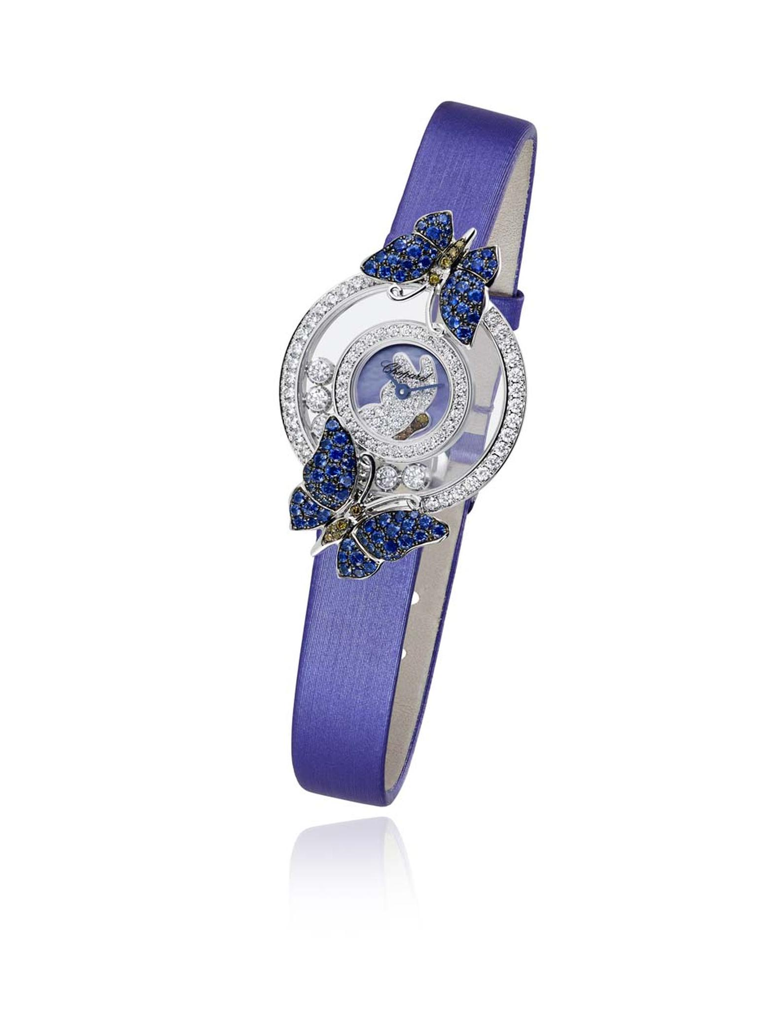 The Chopard Happy Diamonds Butterflies watch features two butterflies decorated with sapphires and brown diamonds, resting on the diamond-set case, with seven mobile diamonds twirling playfully in between