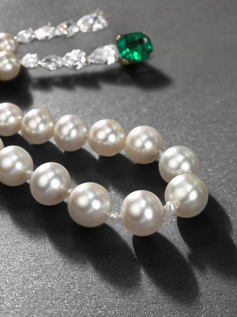 A rare natural pearl necklace with emeralds and diamonds, strung with 23 slightly graduated natural pearls, from Christie's Magnificent Jewels sale in Geneva in 2013, which set a new world record for a piece, selling for $8.5 million.