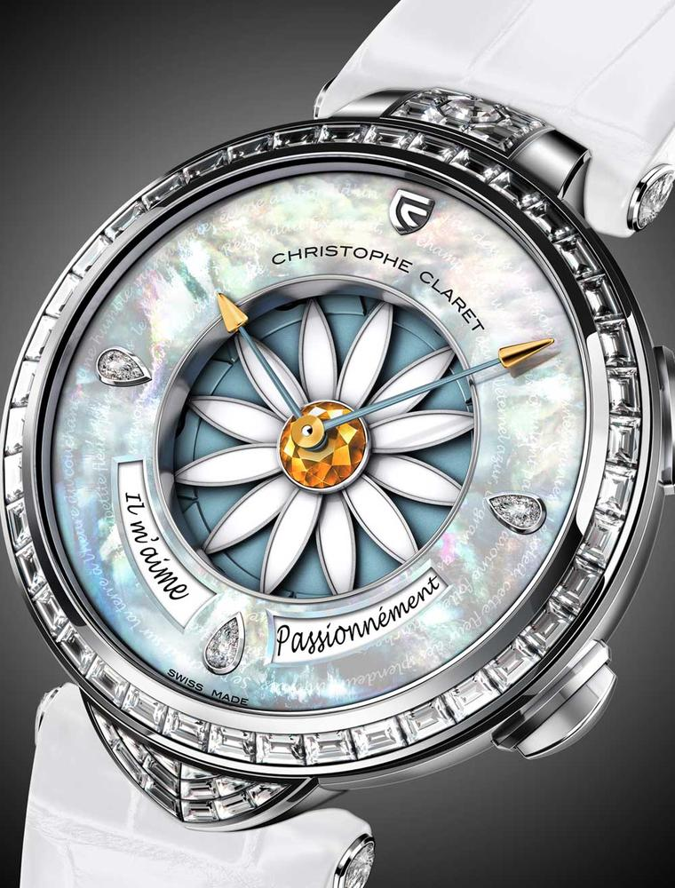 Christophe Claret's Margot watch features a natural blue mother-of-pearl dial inscribed with verses by Victor Hugo encircling the 12 white lacquered petals attached to the yellow sapphire heart.