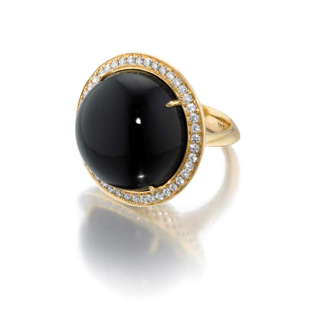 Ray Griffiths yellow gold ring with a central cabochon onyx, surrounded by pavé diamonds