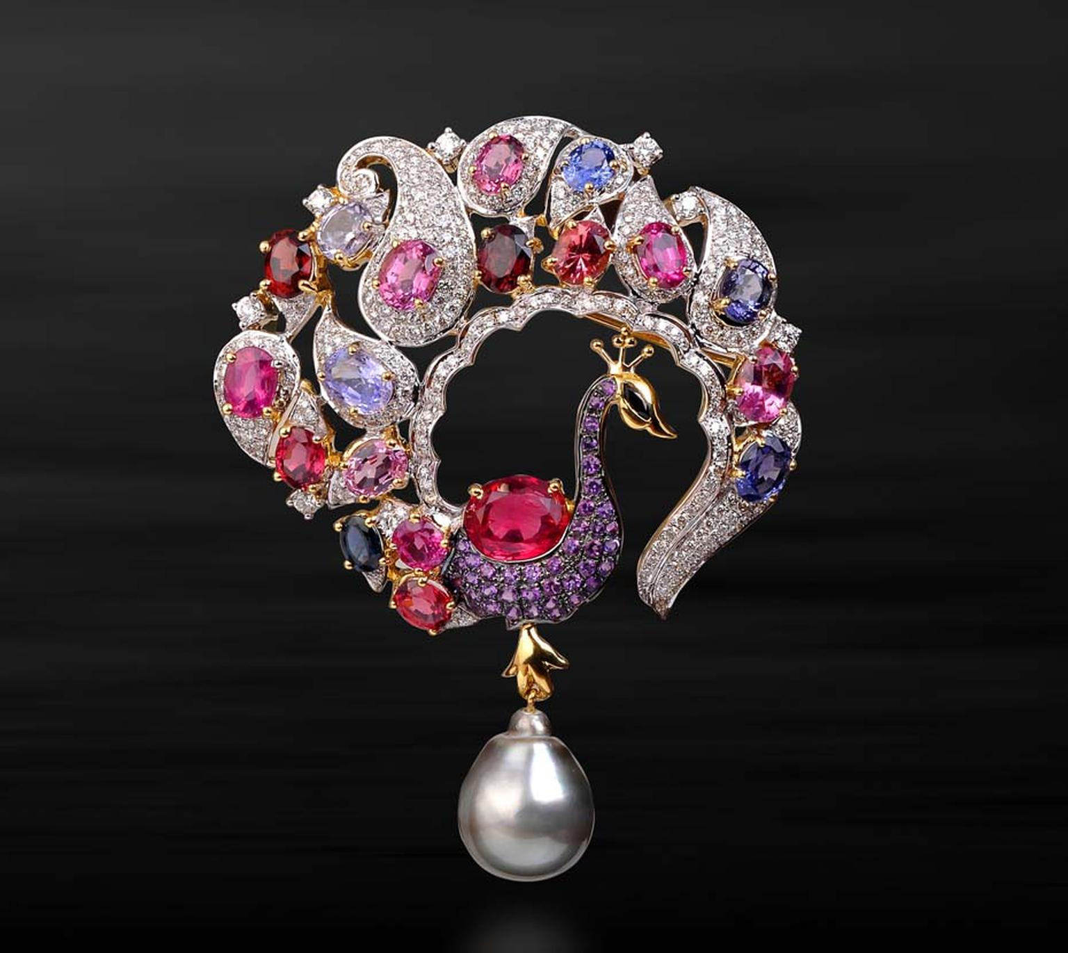 Farah Khan Peacock brooch with a paisley motif tail with a grey pearl, studded with multi-coloured gemstones.