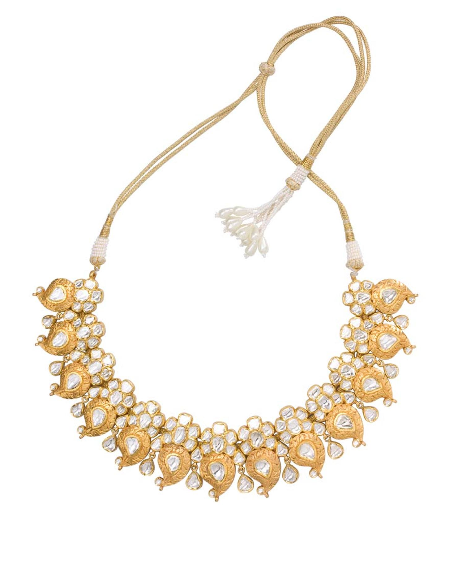 Sunita Shekhawat yellow gold Paisley necklace studded with uncut diamonds.