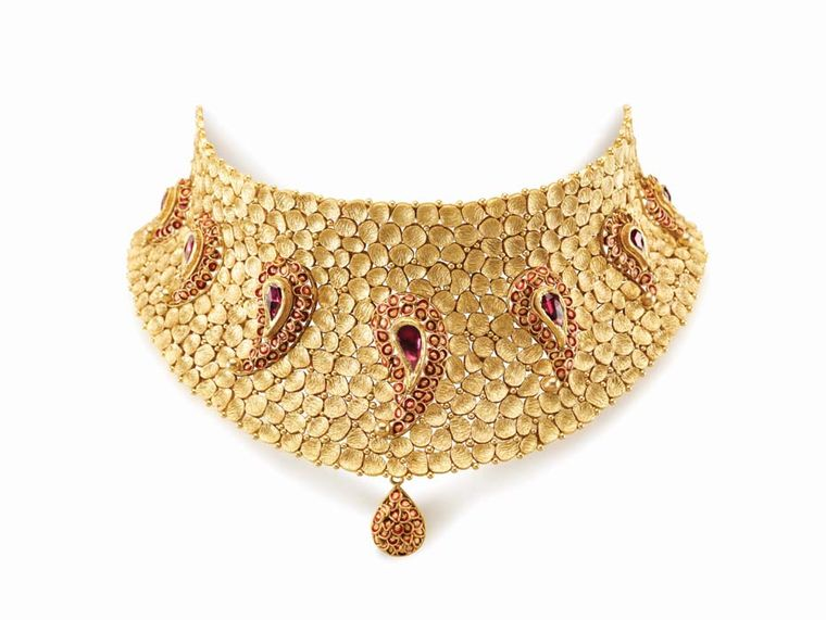 Azva's beaten gold choker necklace with seven paisley motifs, each studded with rubies and decorated with enamel work.