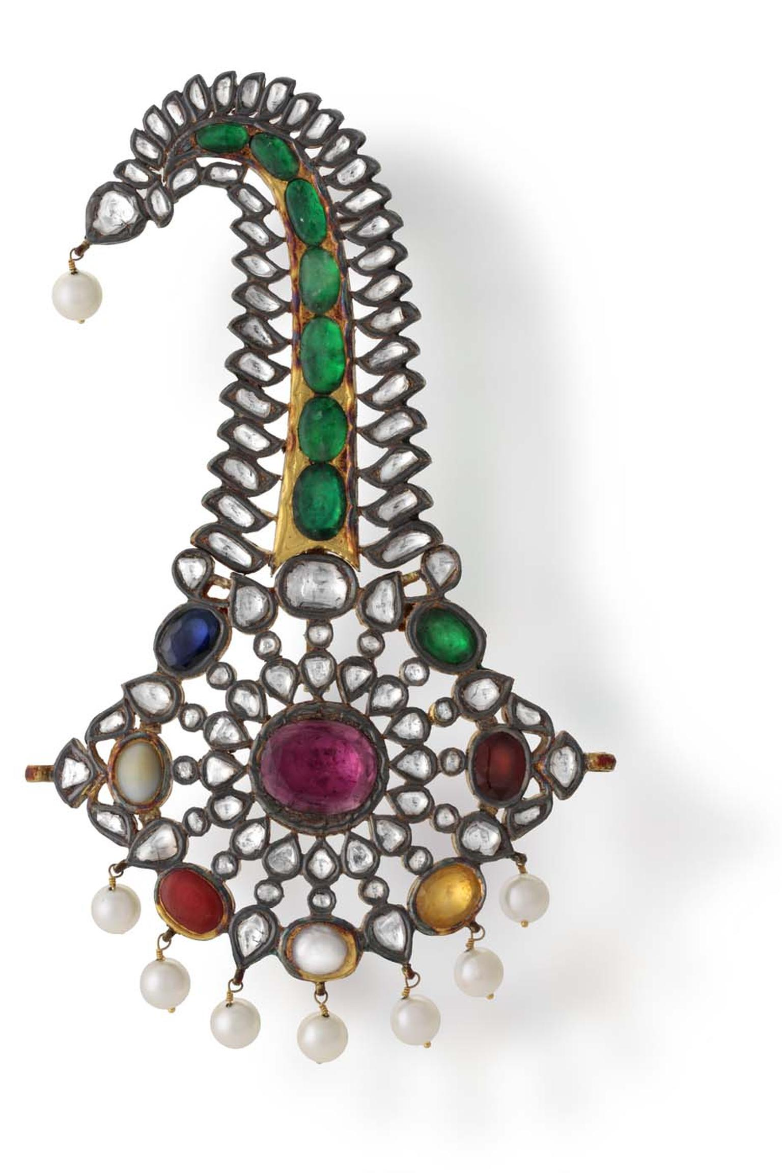 A sacred combination of nine gemstones called a Navratna decorate this Hazoorilal sarpech, which is designed to be worn by a groom on his wedding day.