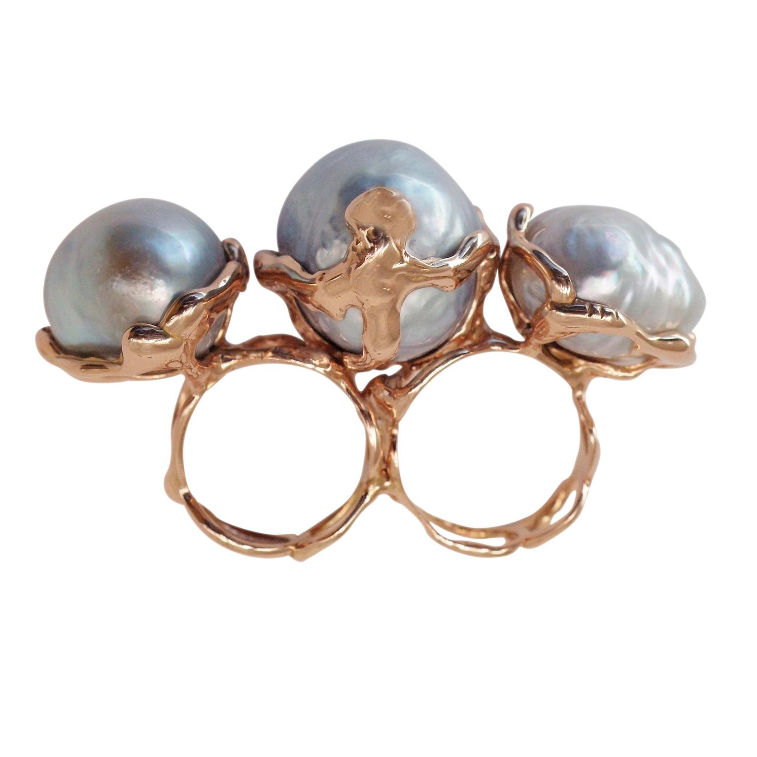Lucifer Vir Honestus multi-finger pearl ring.