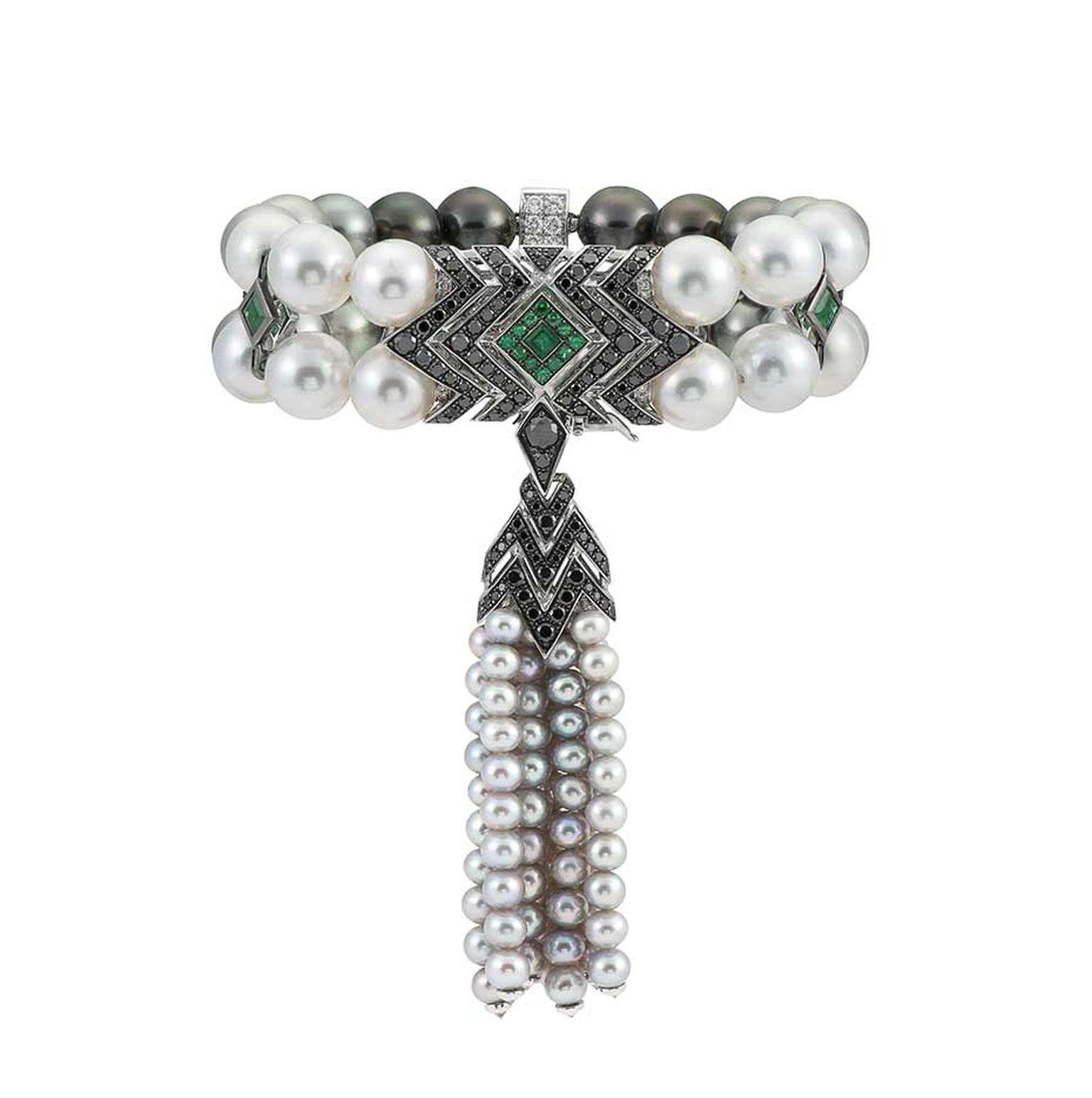 Stephen Webster Lady Stardust pearl tassel bracelet set with black and white diamonds and emeralds.