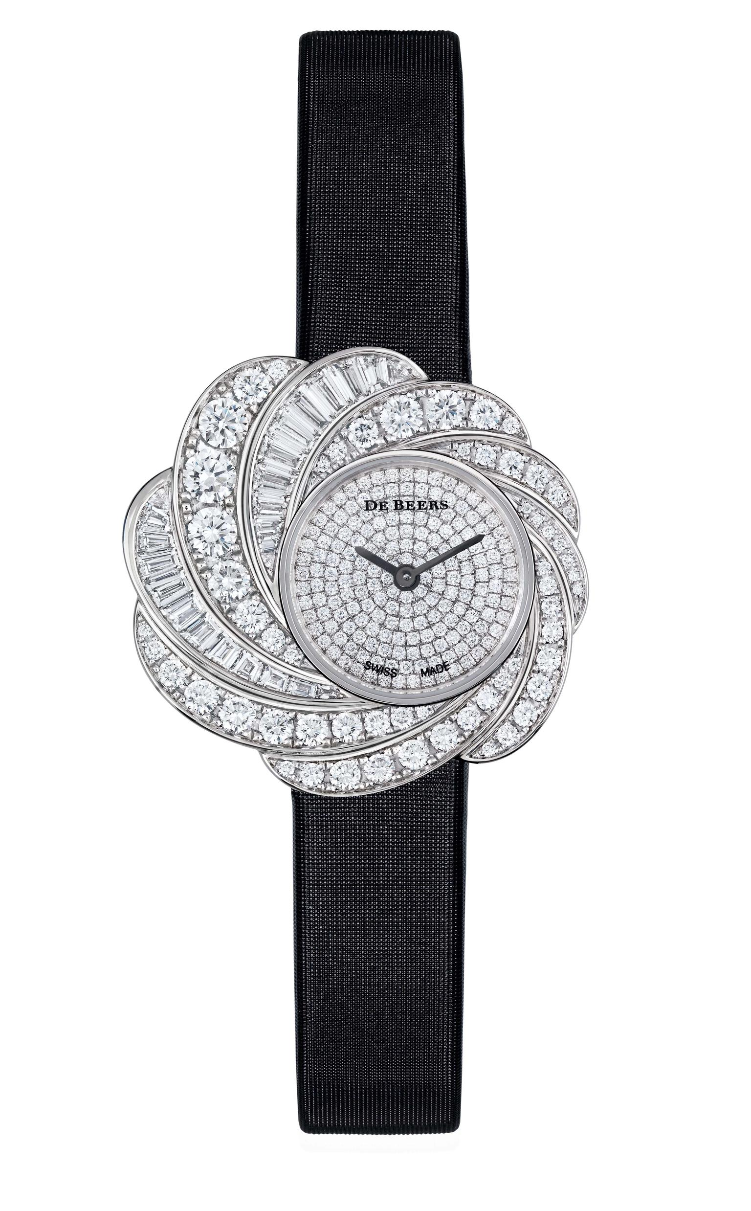 De Beers Aria diamond watch set with round brilliant and baguette-cut diamonds totalling 4.35ct in white gold, with a fully diamond pavéd dial and black satin strap (£POA).