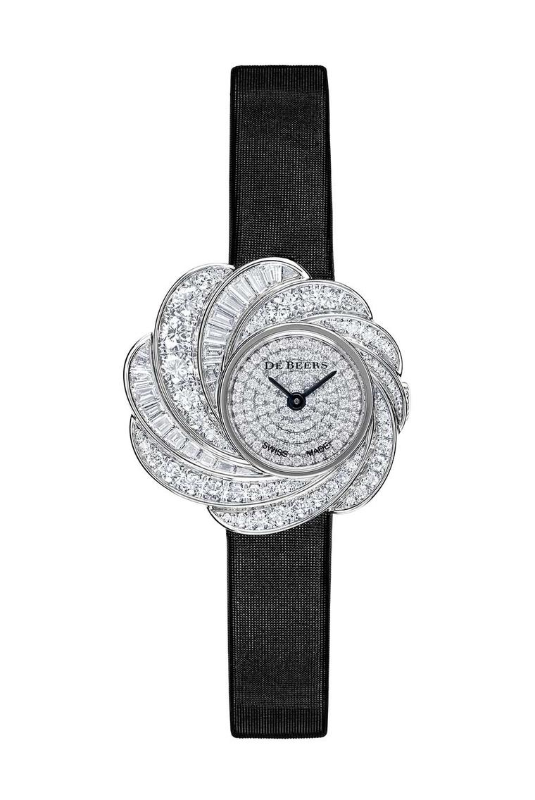 De Beers Aria diamond watch set with round brilliant and baguette-cut diamonds totalling 2.54ct in white gold, with a fully diamond pavéd dial and a black satin strap (£POA).