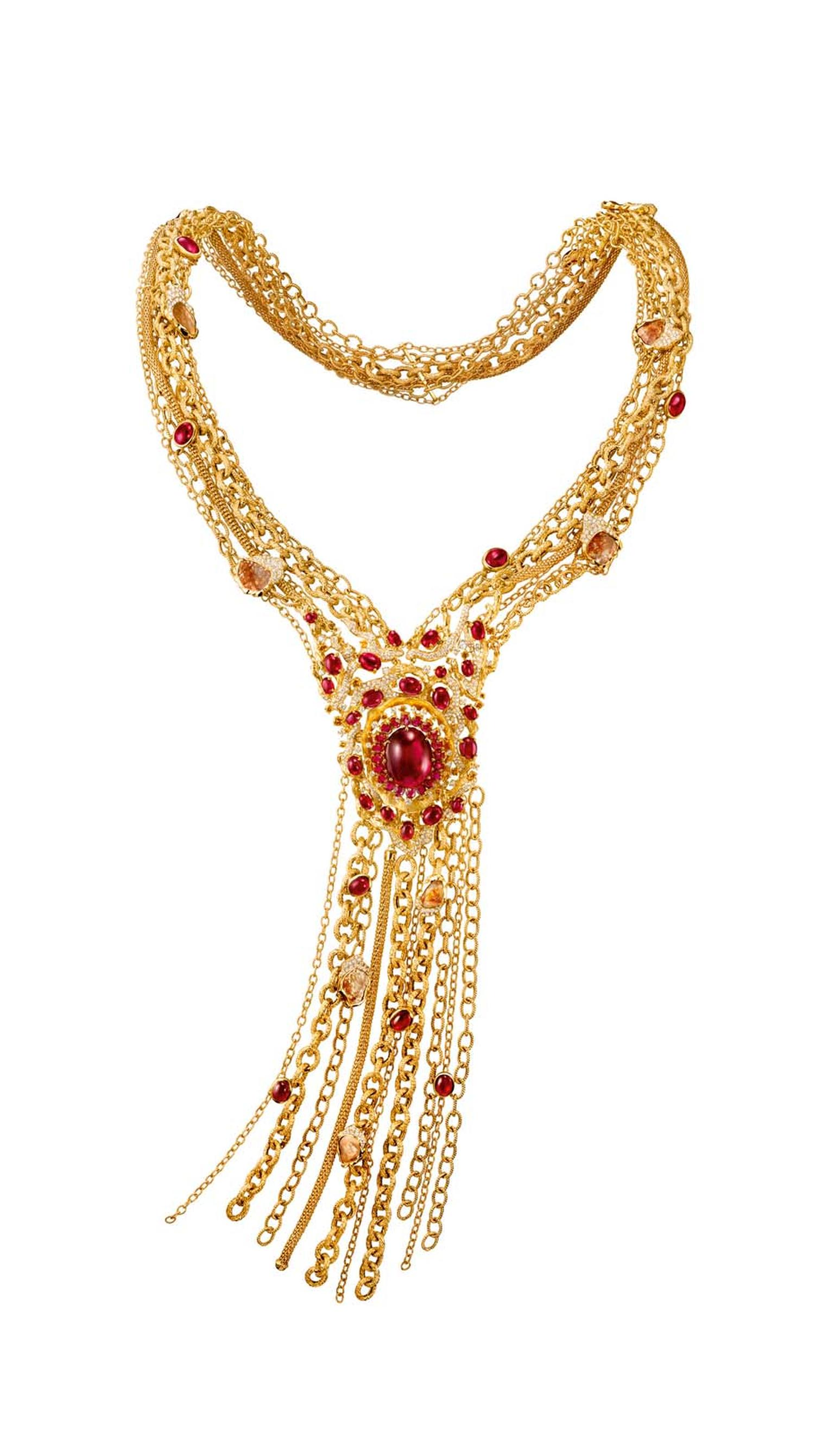 Chow Tai Fook's gold Chant necklace from the Reflections of Siem high jewellery collection, set with a 27.65-carat oval red tourmaline cabochon set in yellow gold, with tassels mimicking the roots of a banyan tree, diamond-studded branches and tourmaline
