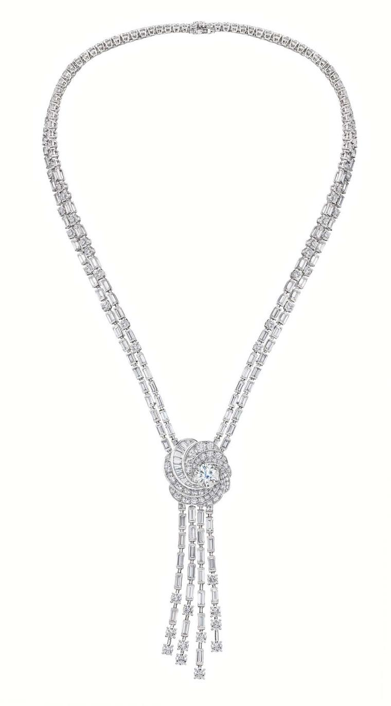De Beers Aria high jewellery necklace in white gold featuring a swirling pendant set with brilliant and baguette-cut diamonds surrounding a brilliant-cut diamond.