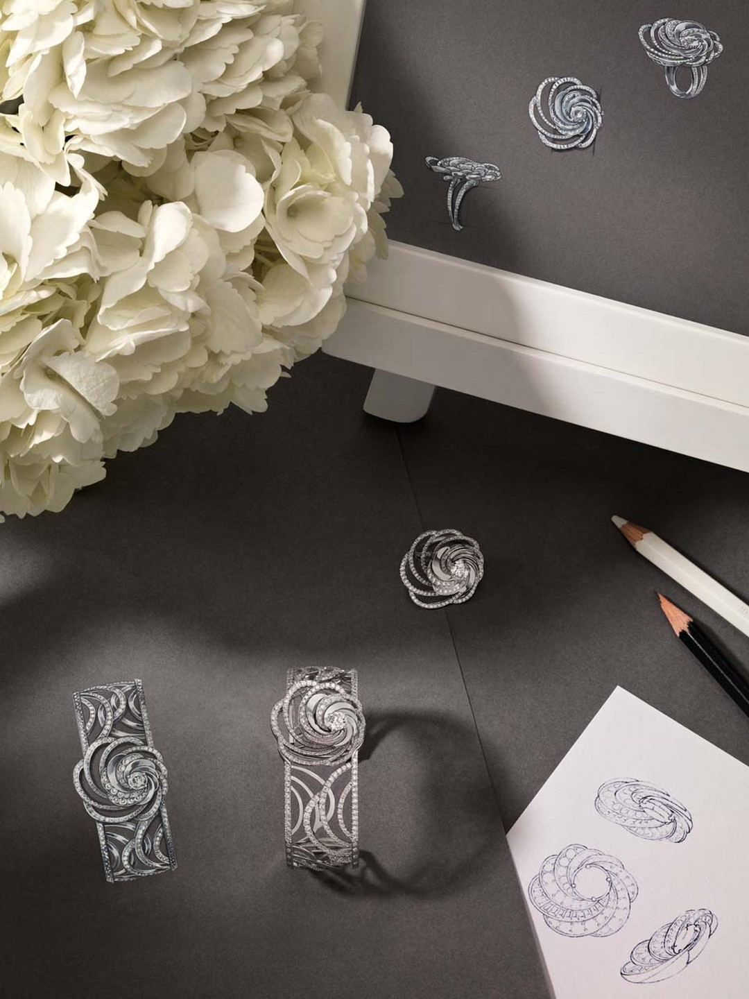 Sketches of De Beers' new Aria jewels alongside a finished bracelet.