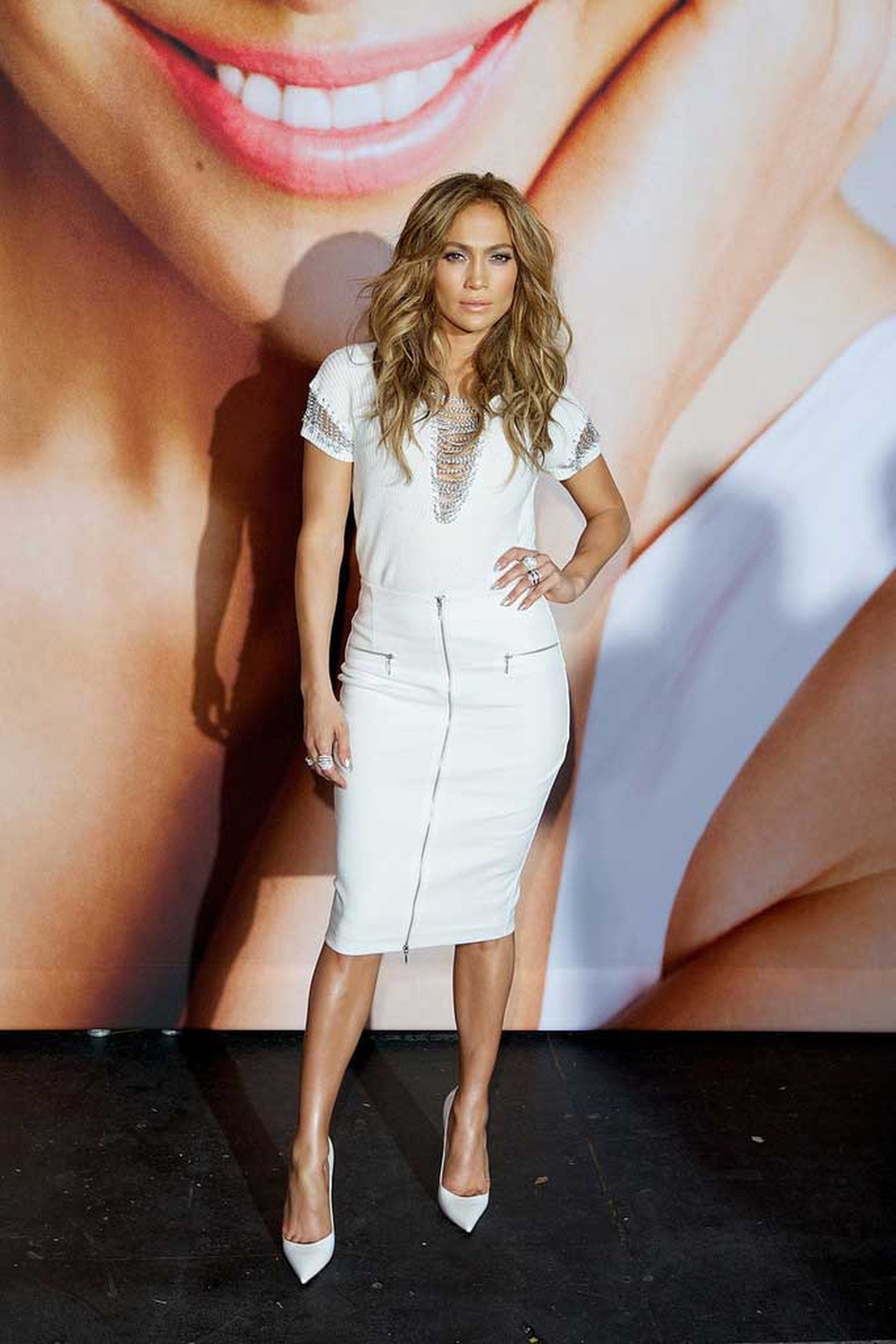 At a private fashion show last Friday, the day after her World Cup performance, Jennifer Lopez paired her slinky chainlink dress with a pair of diamond rings by Demarco.