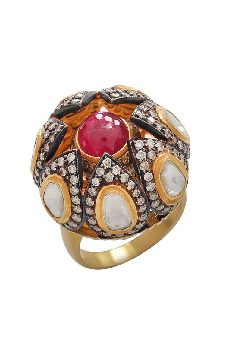 Amrapali Dark Maharaja Shielded Treasure Spin ring in gold and silver, with rubies and diamonds.