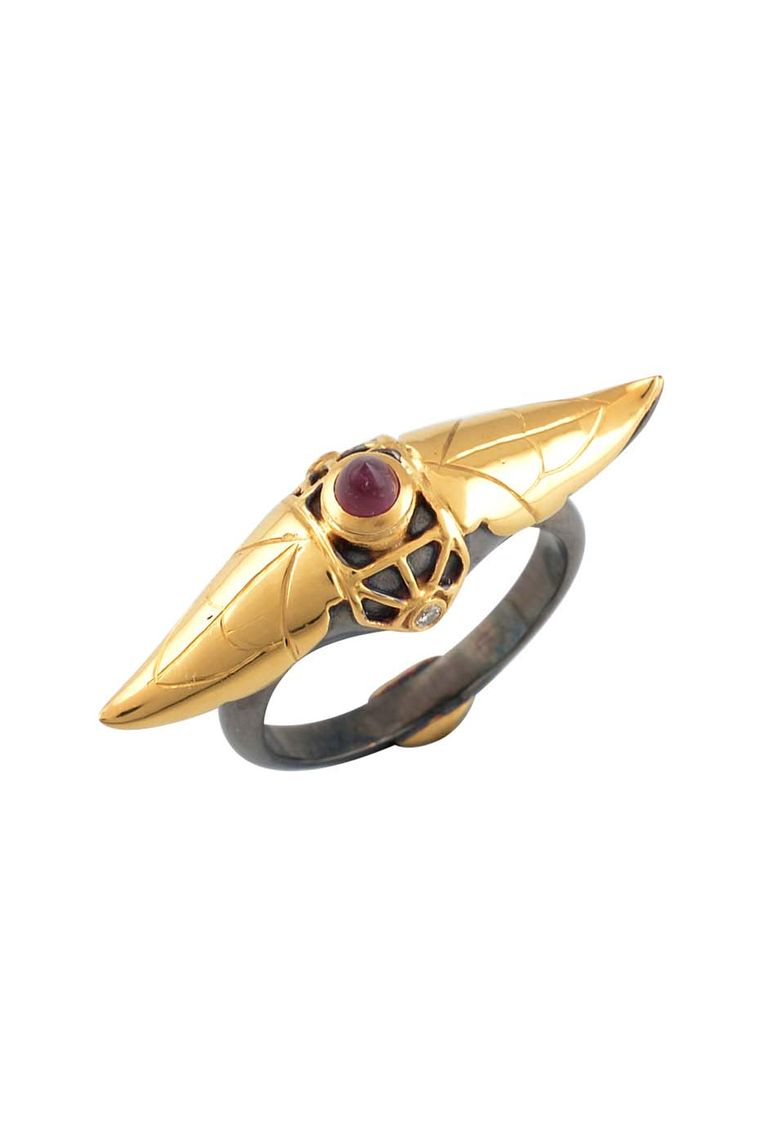 Amrapali Dark Maharaja Dark Arch ring in silver and gold with a central ruby and diamonds.