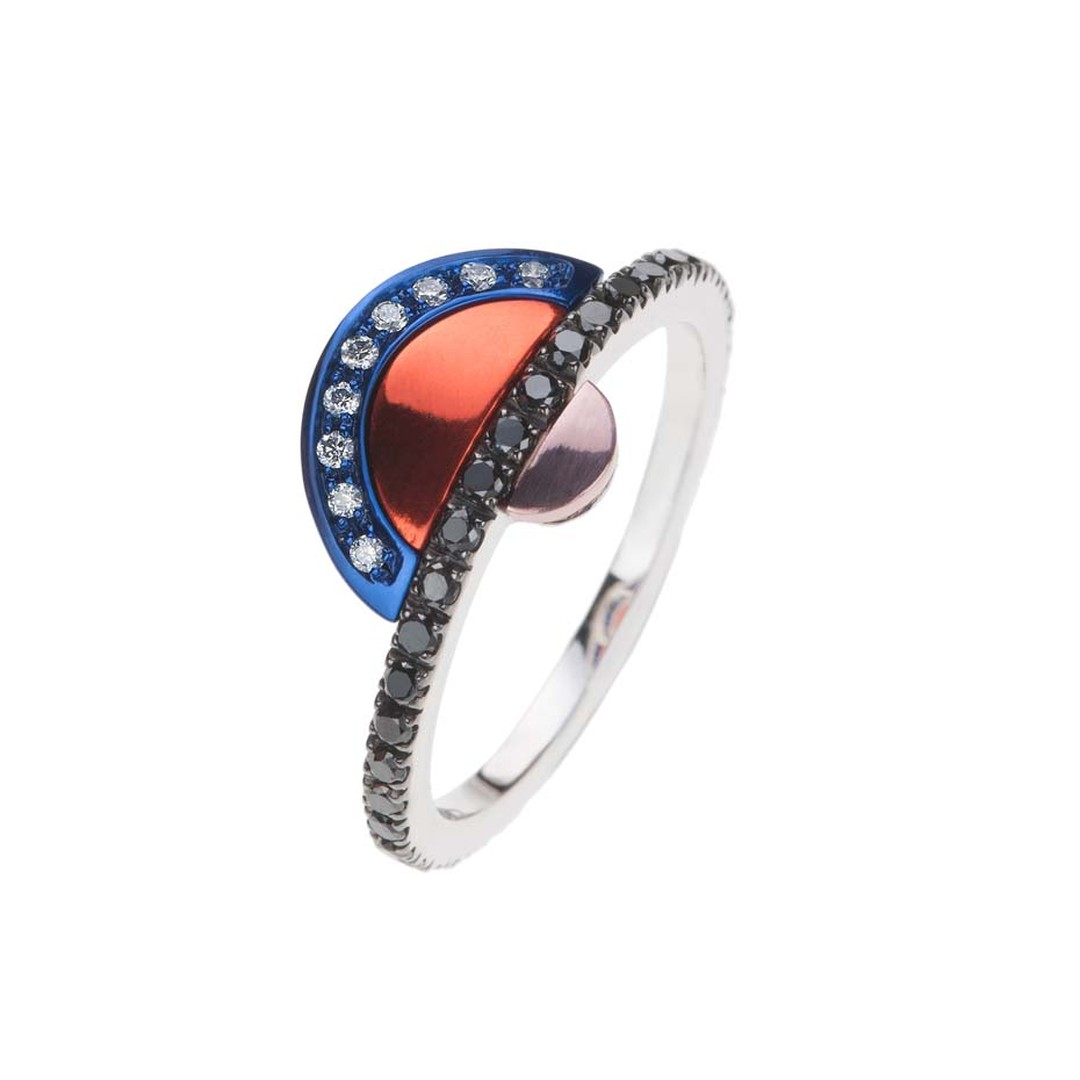 Nikos Koulis ring, from the new Acrobat collection, in black rhodium, with white and black diamonds and white gold hand-painted in blue, orange and pink.