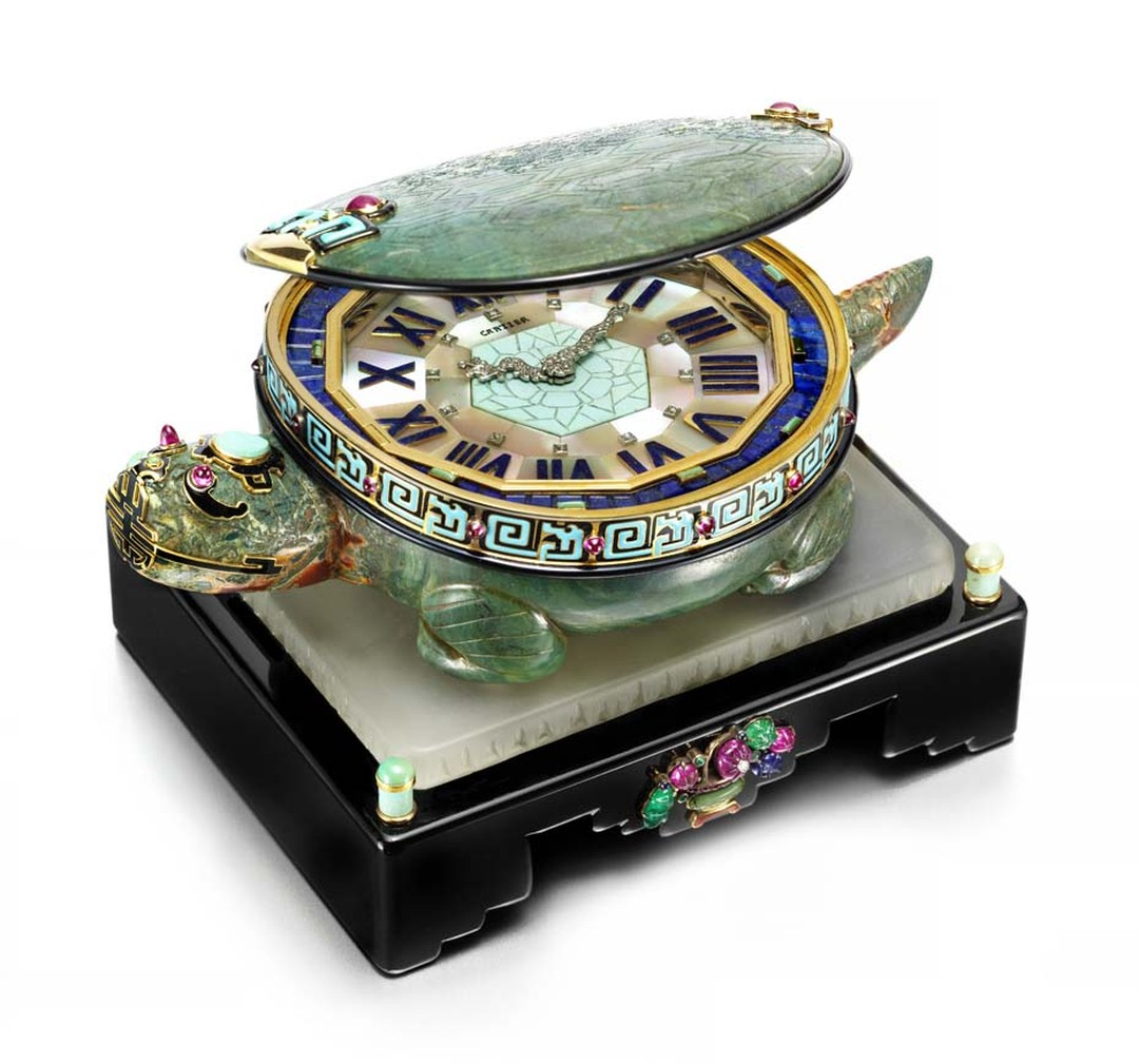 Cartier's 1928 Art Deco Turtle clock, to be exhibited by Siegelson at Masterpiece London, features a clock face edged in gold with diamond-set hands in the form of a dragon, hidden inside a turtle's shell decorated with black and turquoise enamel and ruby